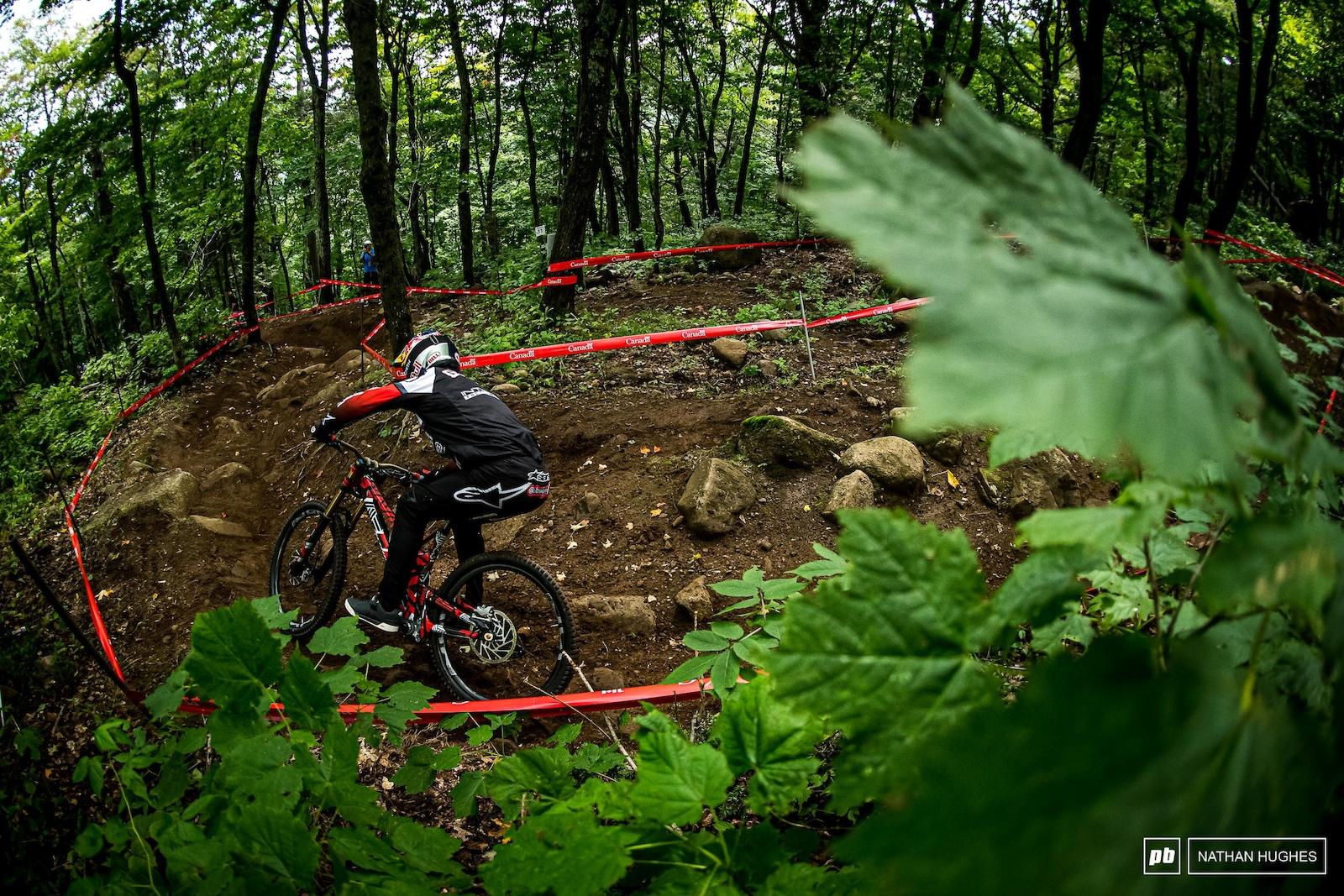 Aaron Gwin piloting his prototype through the deep dark woods.