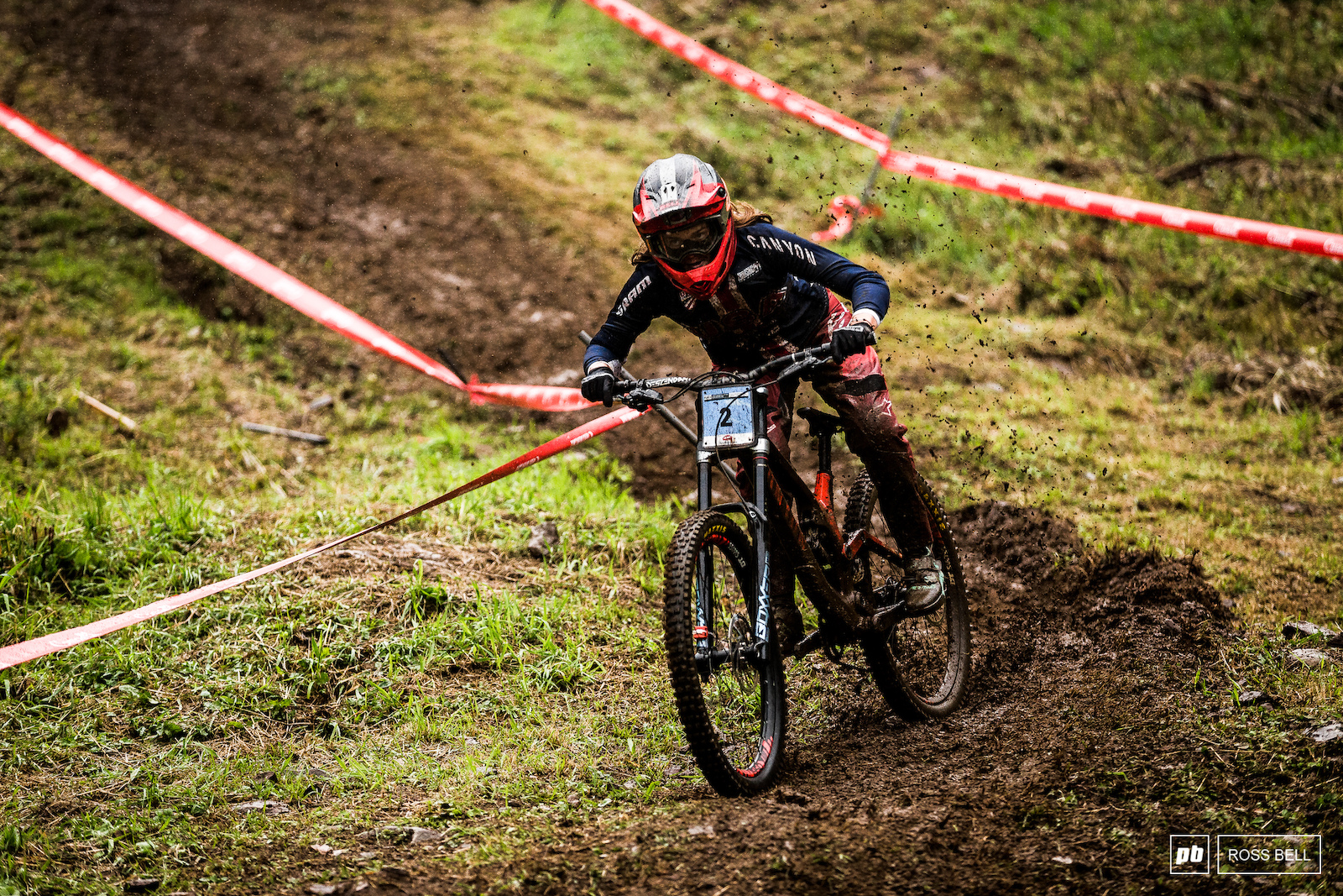 Anna Newkirk looked at ease as the bike squirmed beneath her in the greasy conditions.