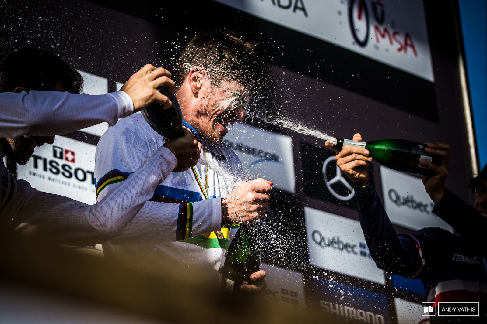 Bruni Powerwashed with champagne before he can even pop his own.