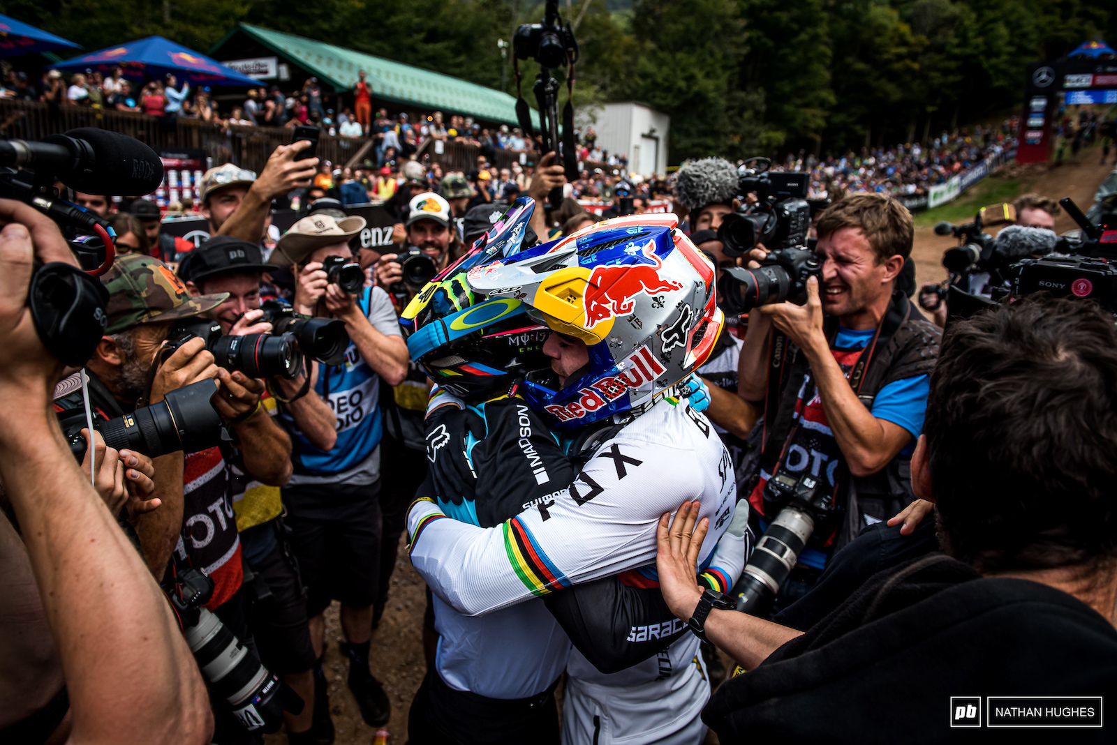 The ally that won the war... Bruni hugs new best friend for life Hart who s victory over Pierron gave him the title.