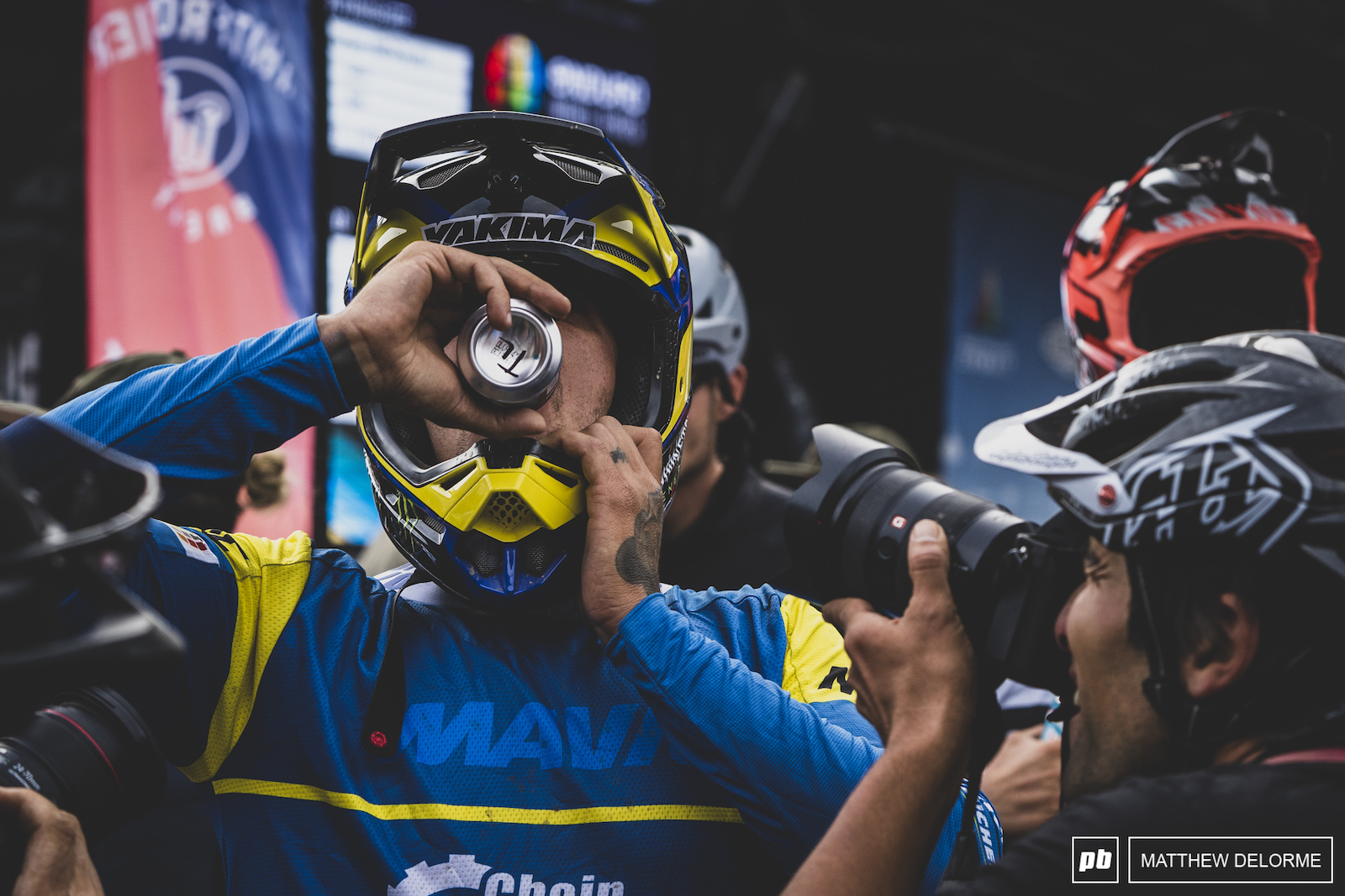 Sam Hill chugs a cold one at the finish.