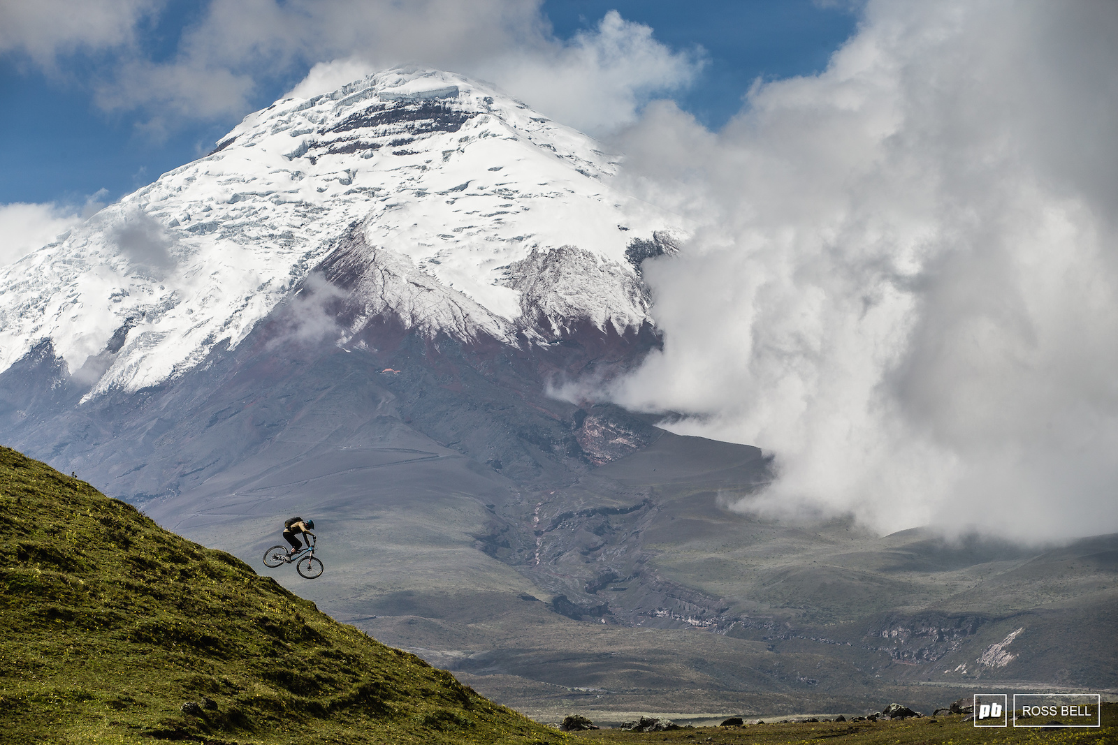 Thomas Vanderham dwarfed by Cotopaxi in Ecuador.