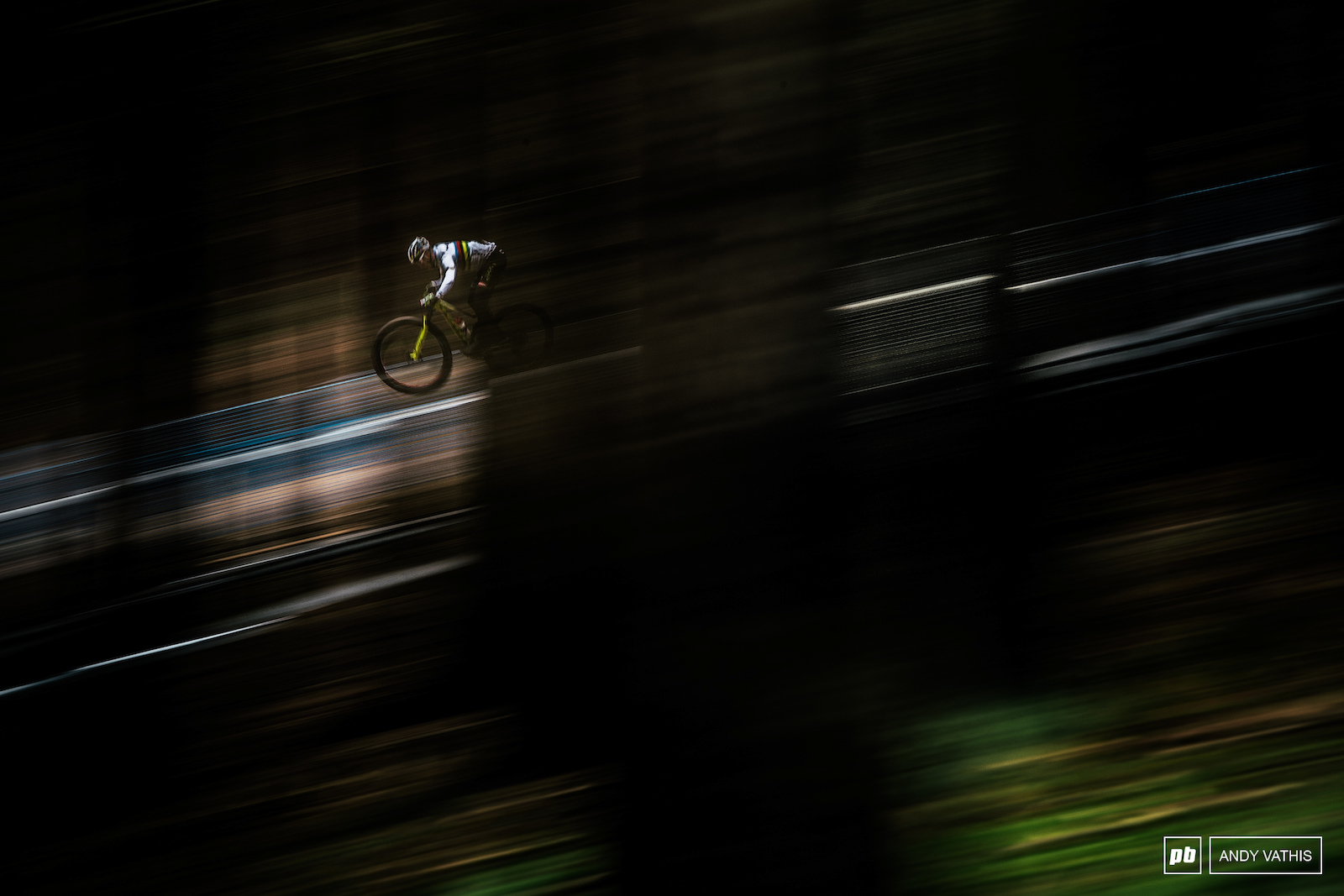 The dense yet neatly spaced forest that is Nove Mesto offers unique sight lines through the trees perfect for pans and pots of light. Nino Schurter making quick work of the BMX section.