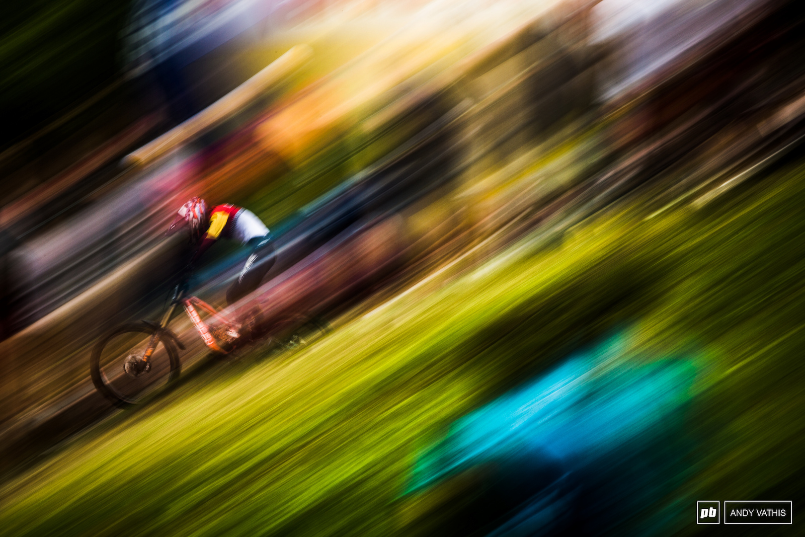 Colorful pans down the Val Di Sole ski jump as riders blast down to the finish at full tilt.