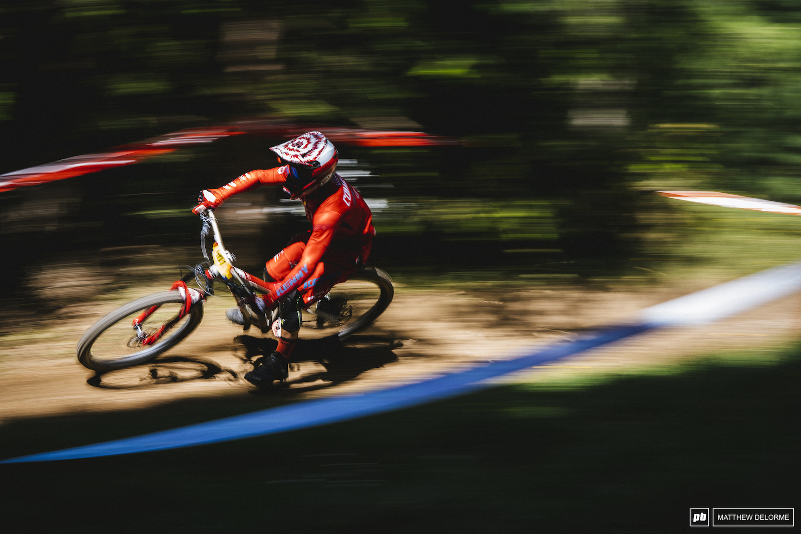Antoine Vidal speeds through the forest in Val Di Fassa Italy