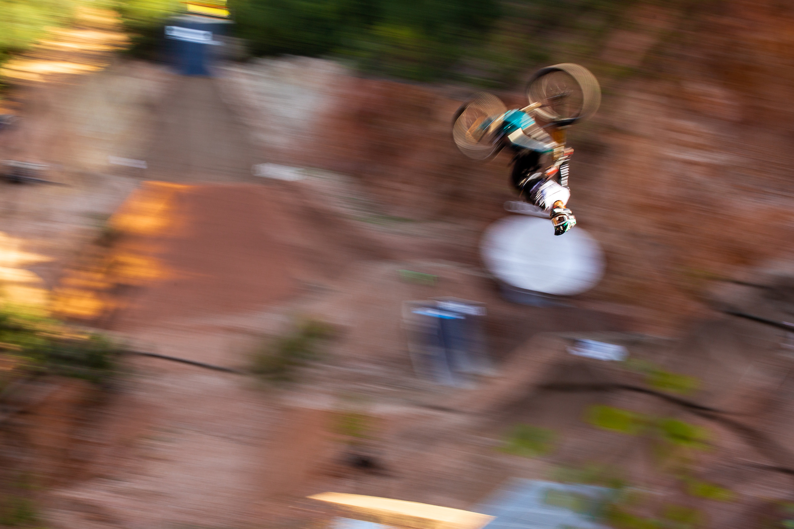 TombPhoto - Bienve flipping the massive hip at the top of the Audi Nines freeride line