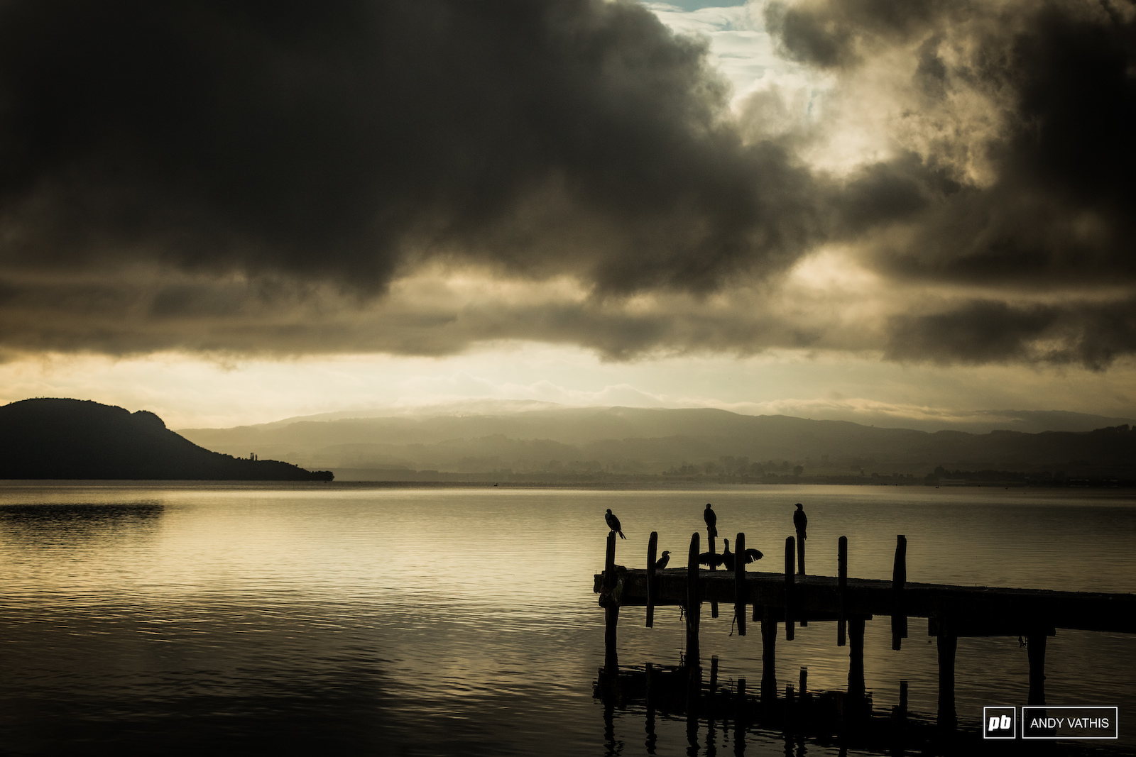 Still mornings on Lake Rotorua as the sun begins to peak out through the clouds.