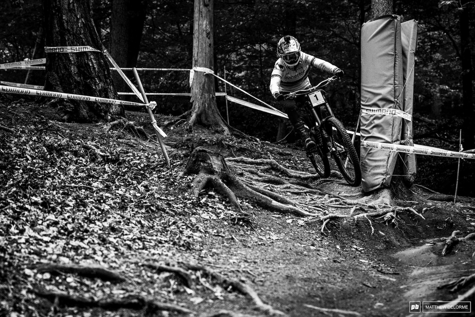 Rachel Atherton skimming over the roots.