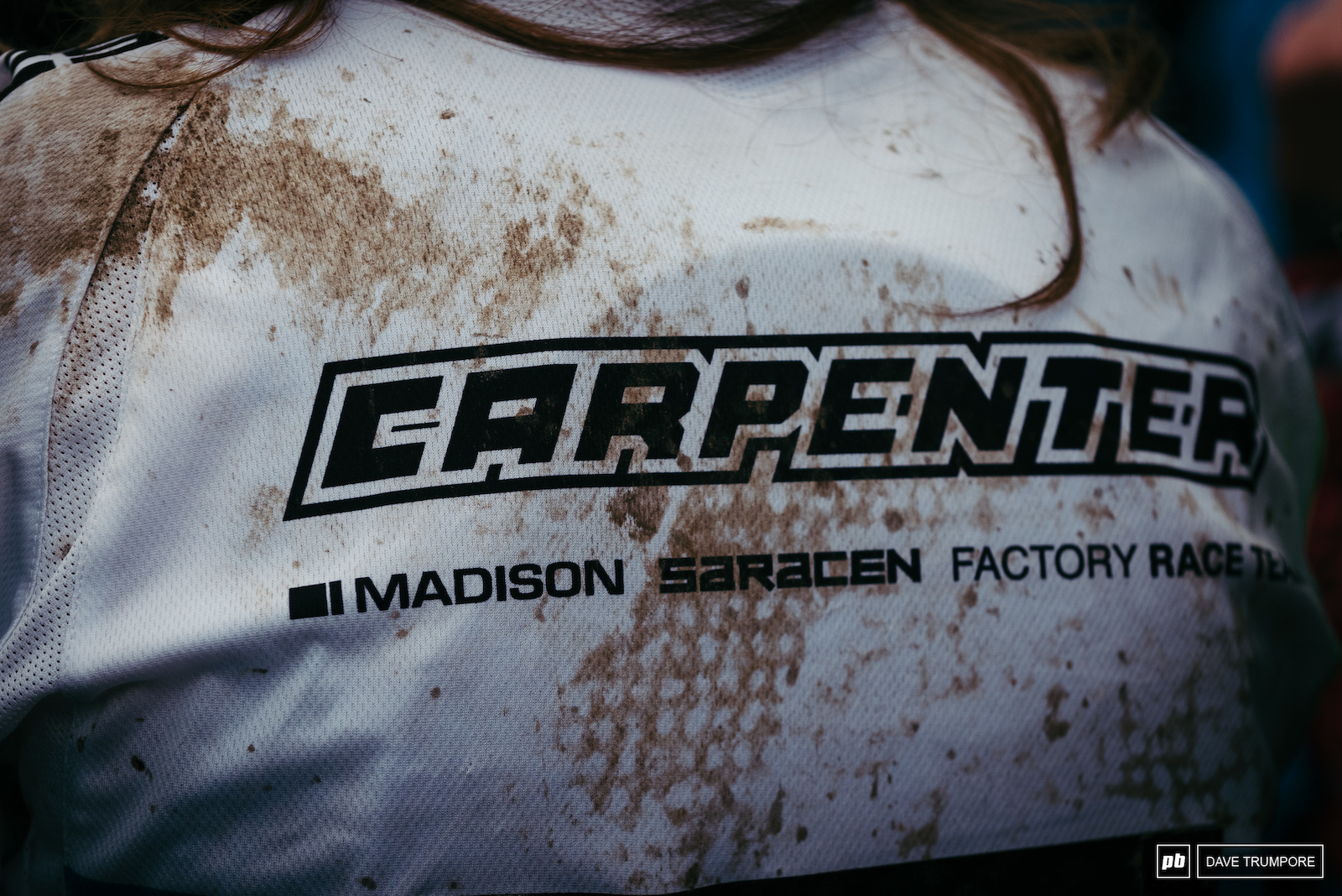 The dirt on the back of the jersey tells the tale of the day for Manon Carpenter - 2015