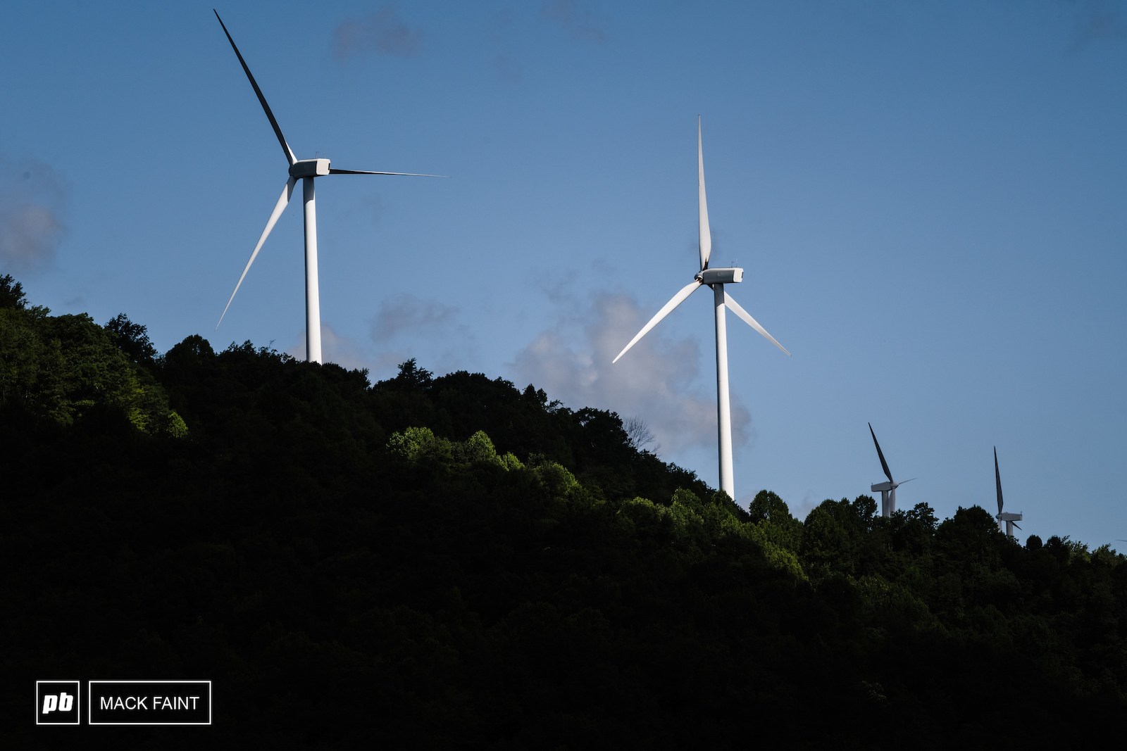 Not visible from the parking area but windrock his home to many wind turbines at the top.