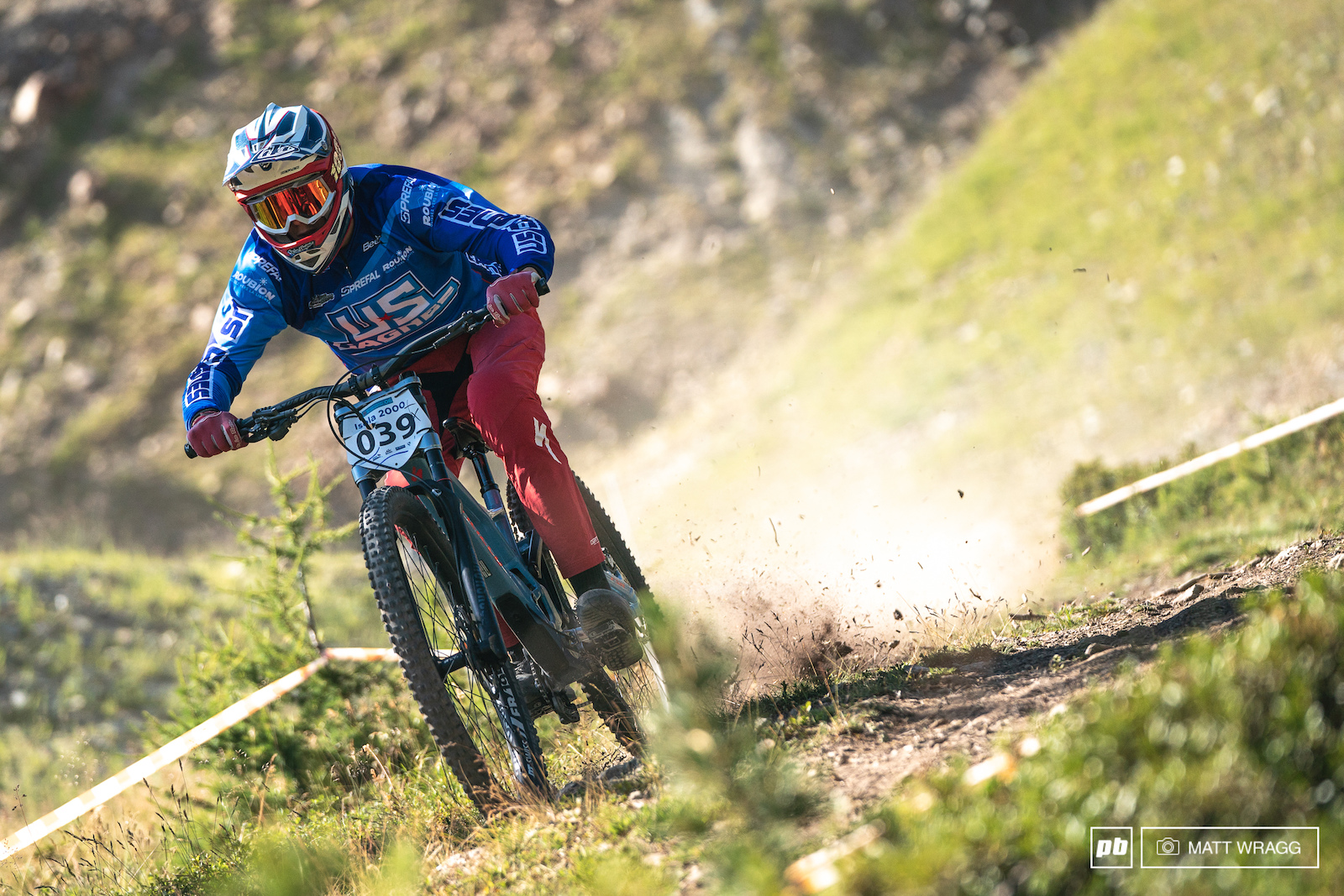 Nicolas Morel tearing up the alpine meadow on the upper part of the course.