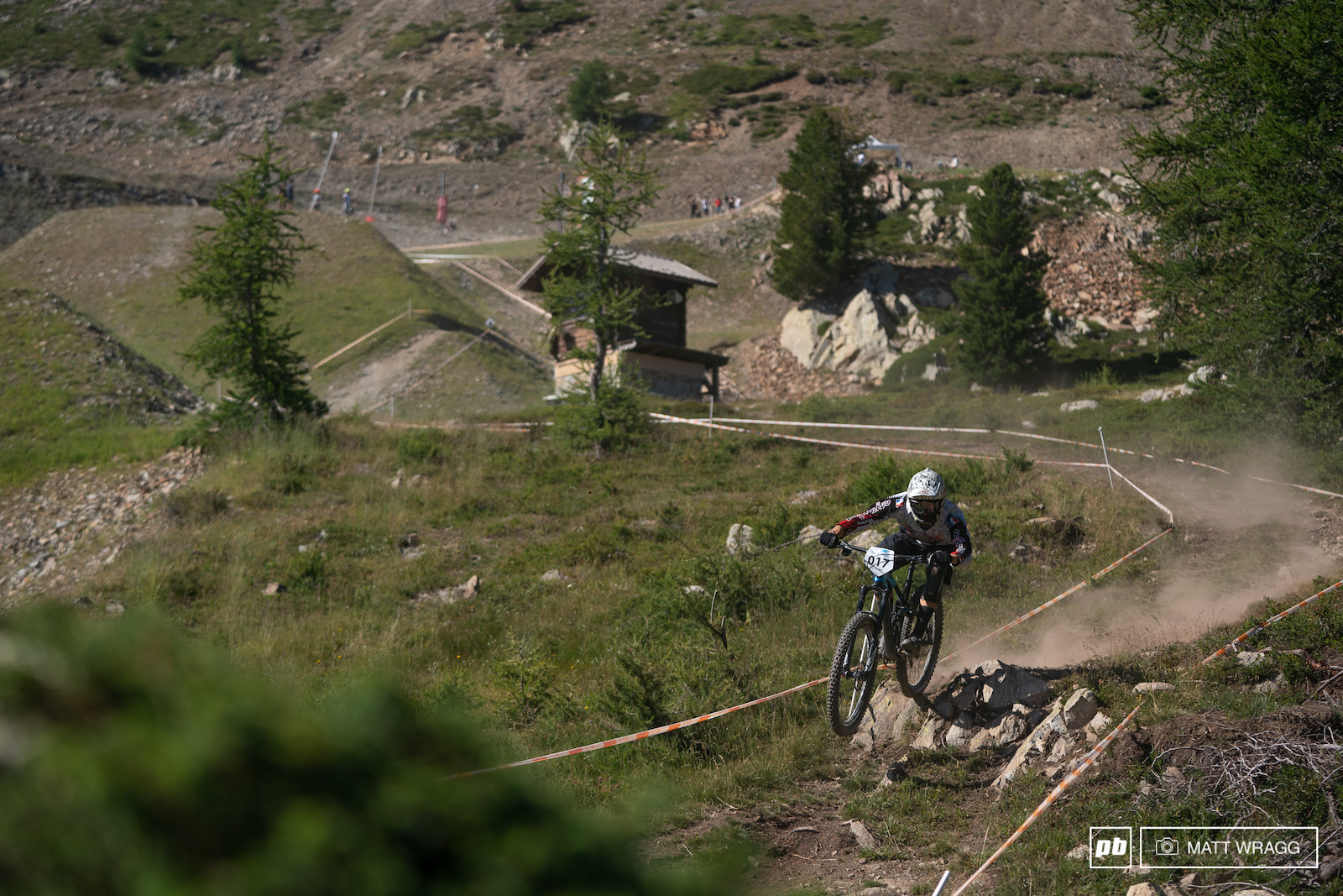 Antoine Macagno hits the drop that marked the transition from meadow to tigher singletrack through the trees.
