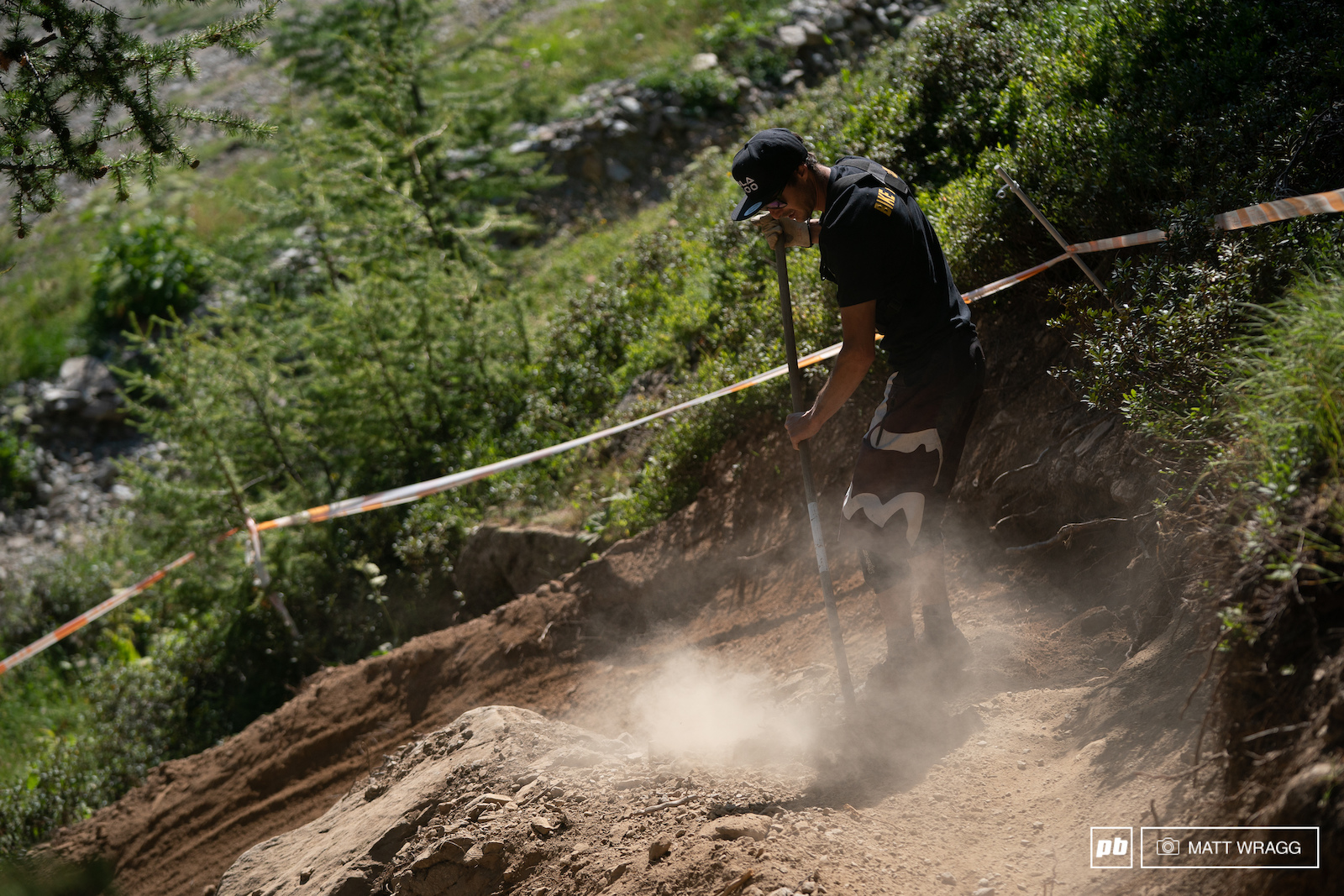 In France they call the trail builders shapeurs pronounced shay-pers . This is Damien the shapeur here in Isola making sure the track is ready for the race runs.