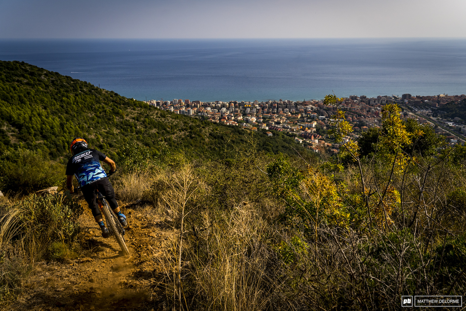 After four stages and a hell of a lot of pedaling the view of the sea as you dive into stage five is a welcome sight.