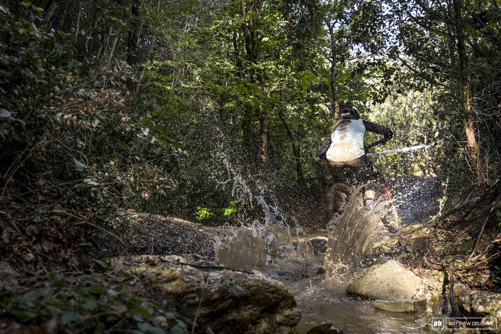 Chloe Gallean plows through the post deluge creek on stage 2.