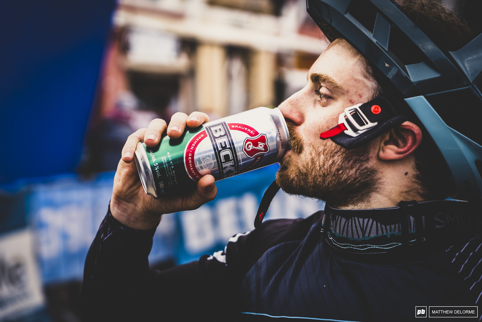 Jesse Melamed tosses back a well deserved beer after a brilliant day on the bike.