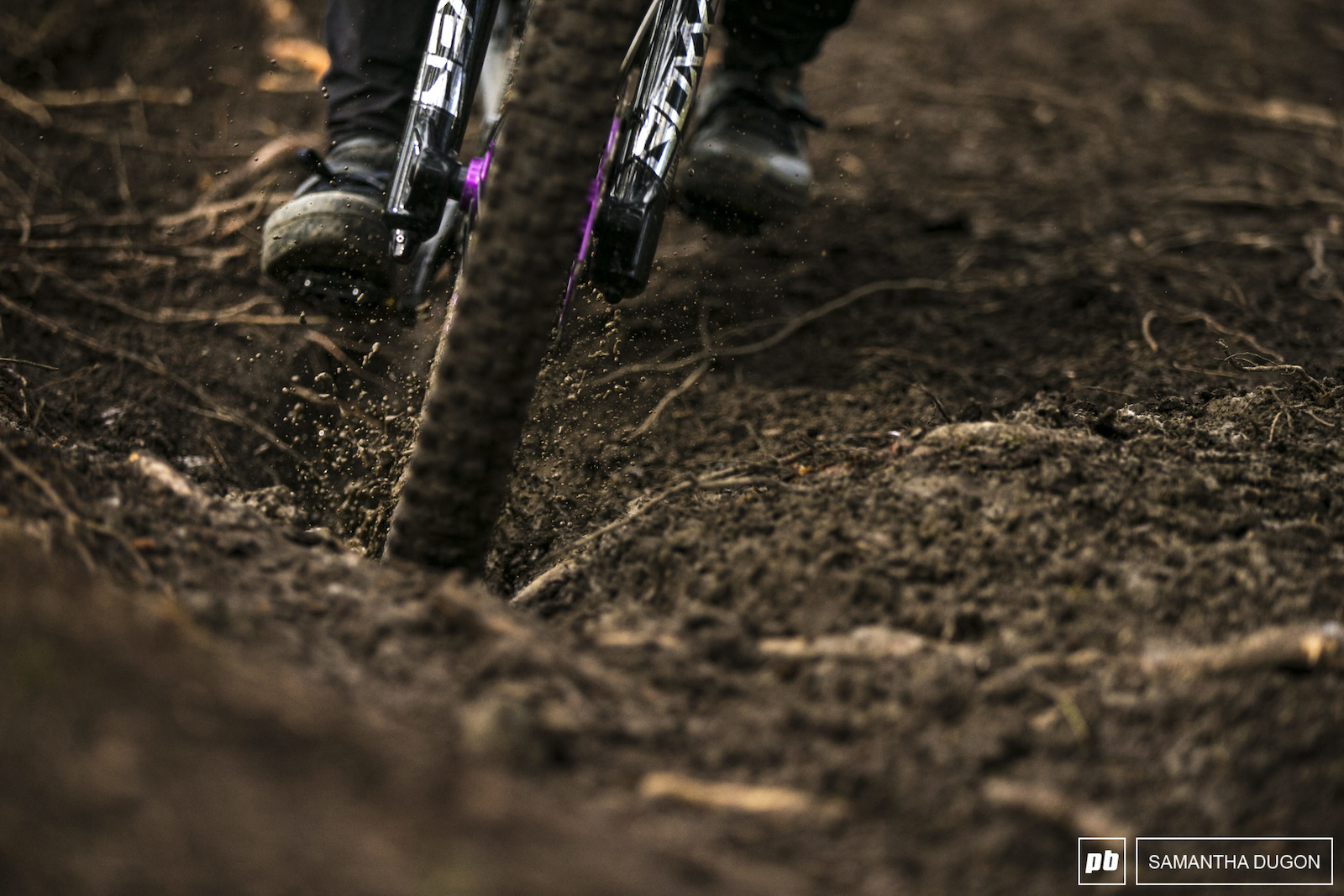 Pockets of slop coated the roots in a slick coating as riders got further down the track.