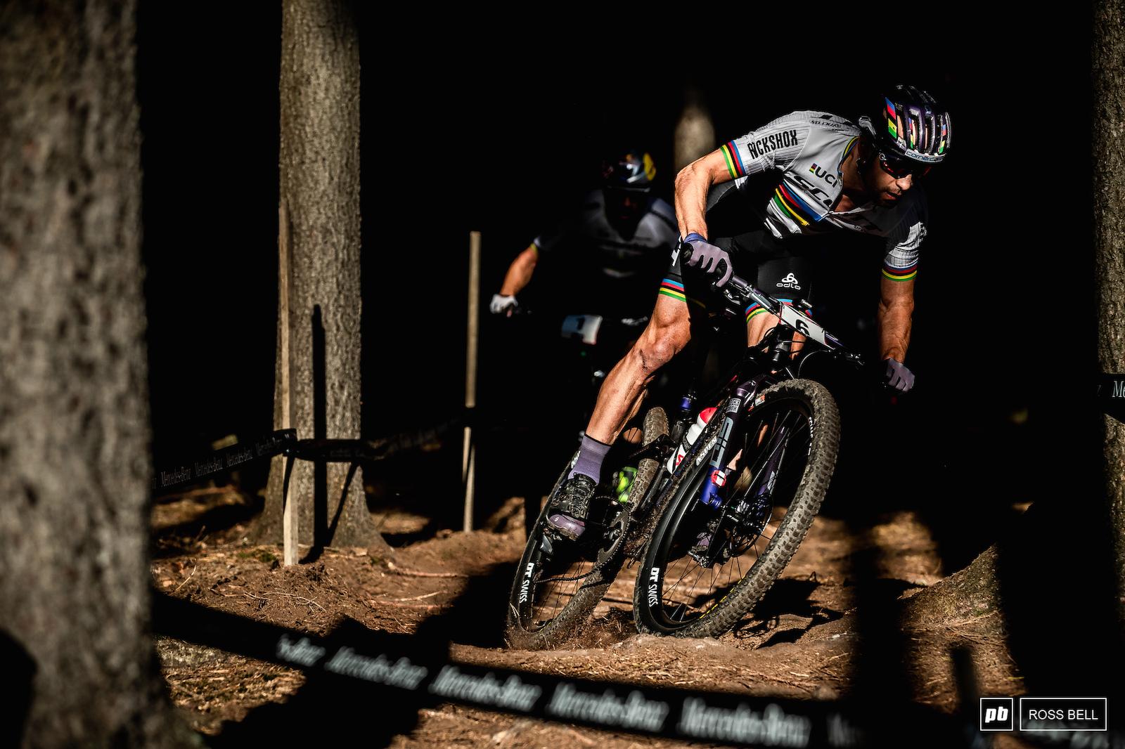 Henrique Avancini lurks in the wheel tracks of nemesis Nino Schurter.