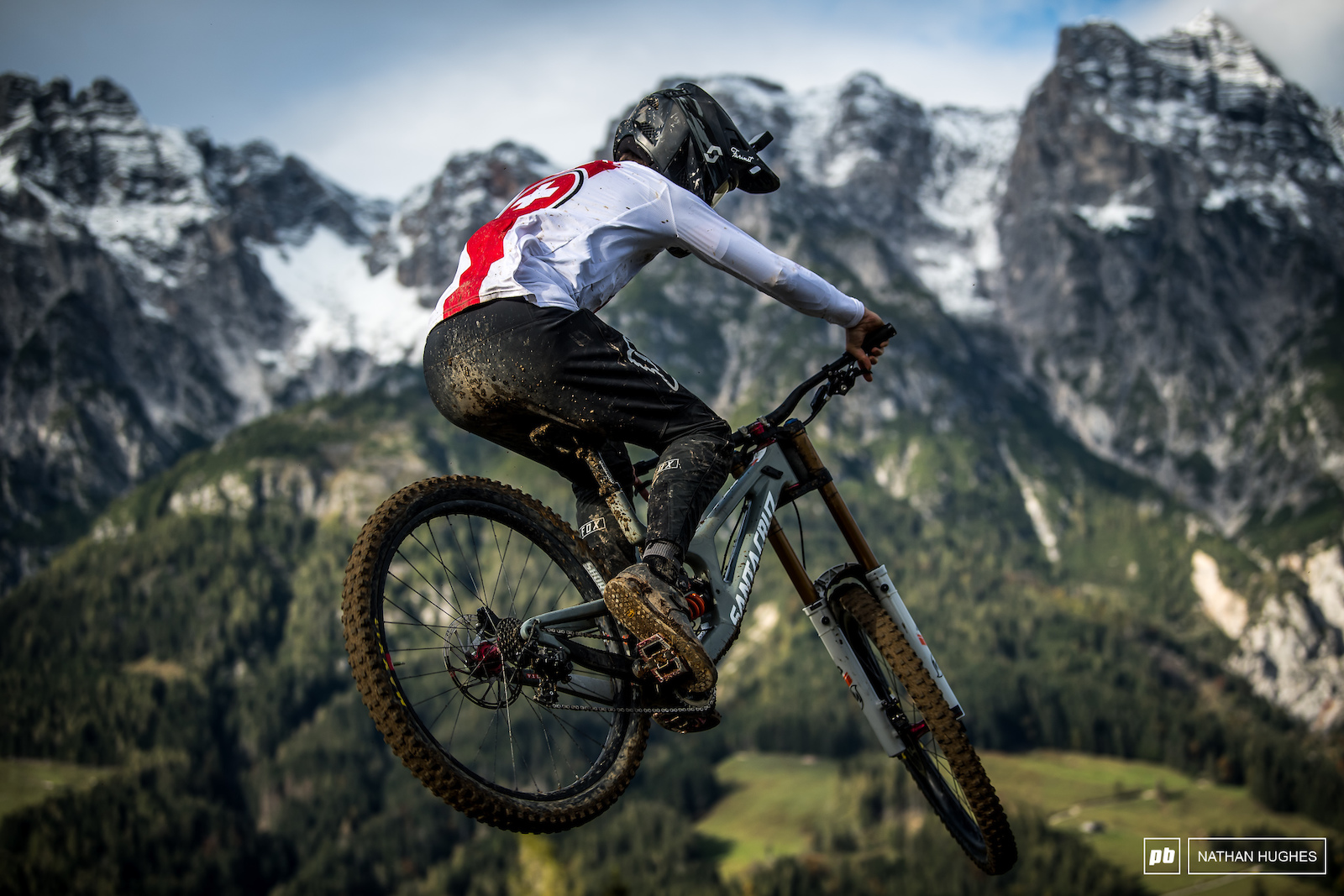 Jerome Caroli repping Switzerland infront of the rival mountains.