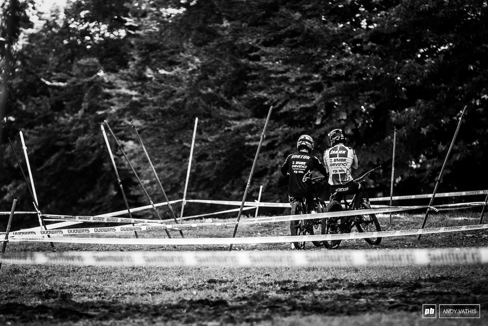 The Devinci boys discussing line variations before dropping into the bottom of the course.