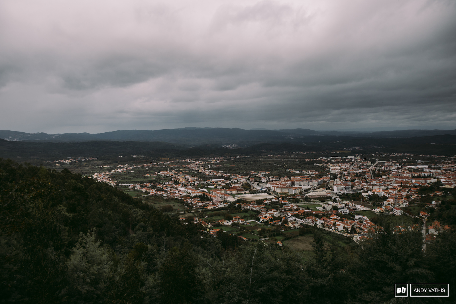 The town of Lousa under a blanket of rain clouds.