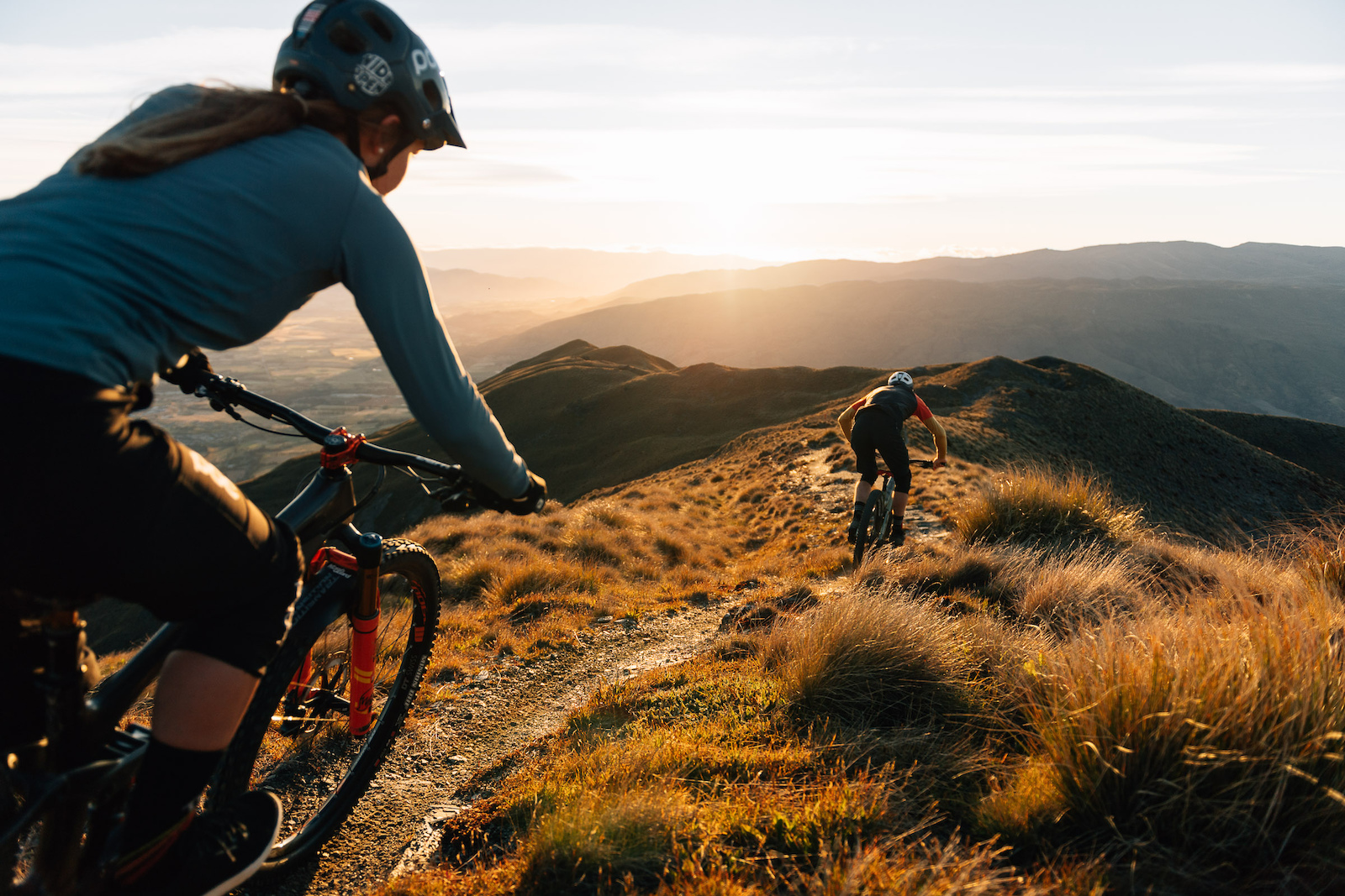 Brooke chases Conor down a special section of single track easiest to get to by helicopter.