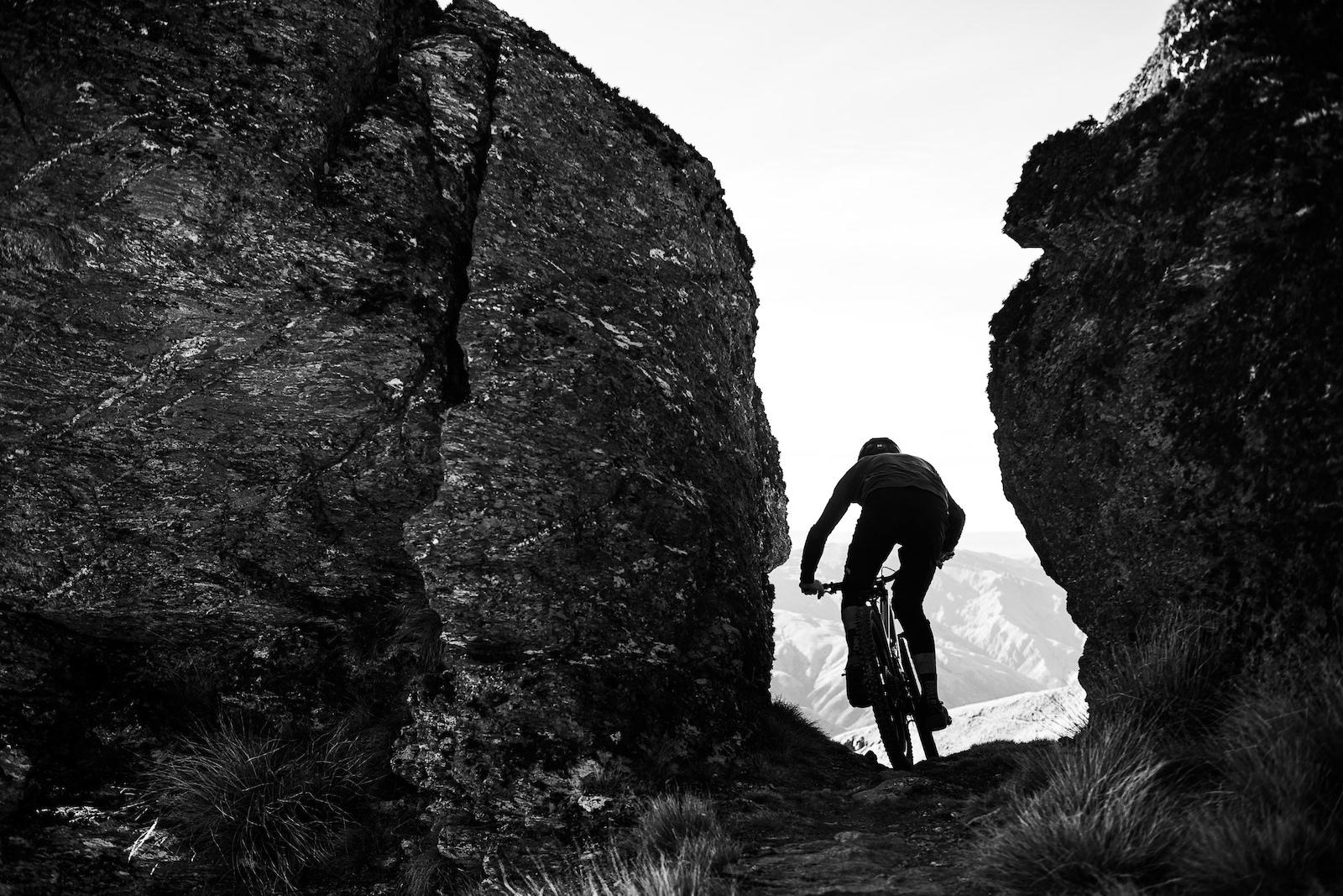 Conor squeezes between two rock pillars.
