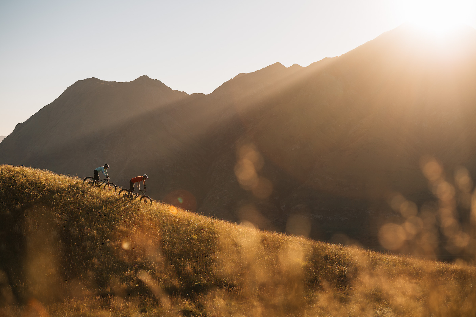 Cruising down the ridgeline as the sun comes up over the park.