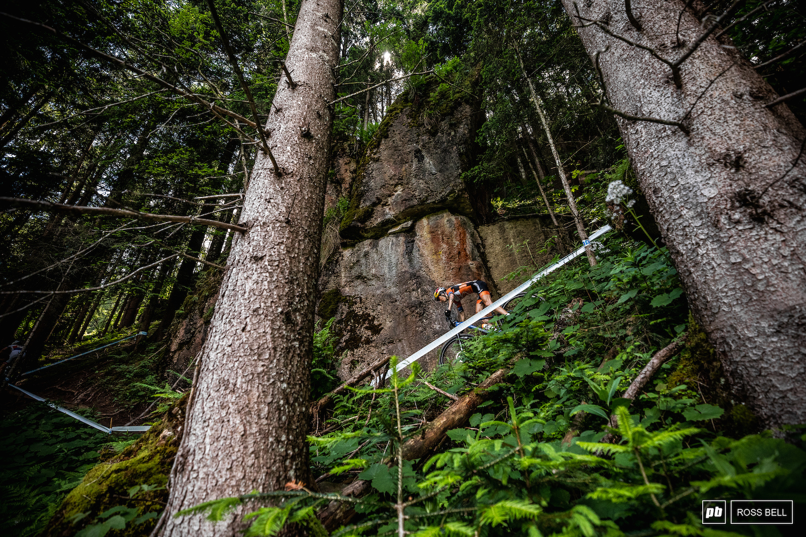 The Leogang XC track is a wild one Yana Belomoina dwarfed by an overhanging rock face.