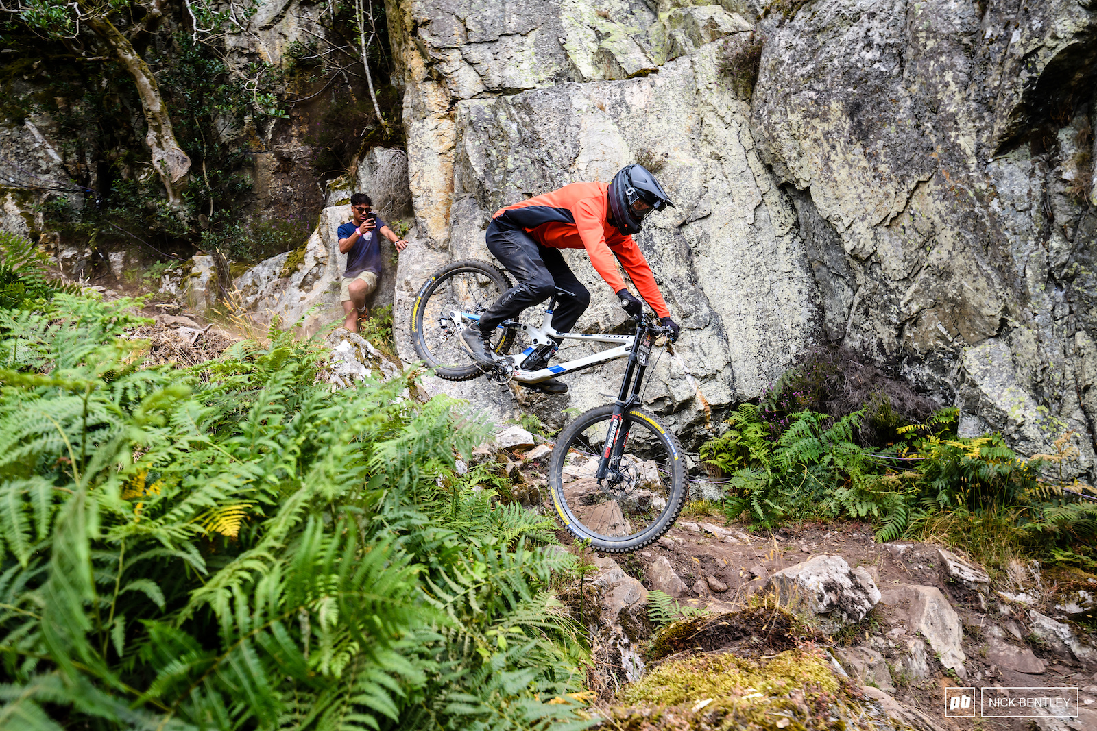 Vincent Turpin making his way through the technical rock section above the road gap.