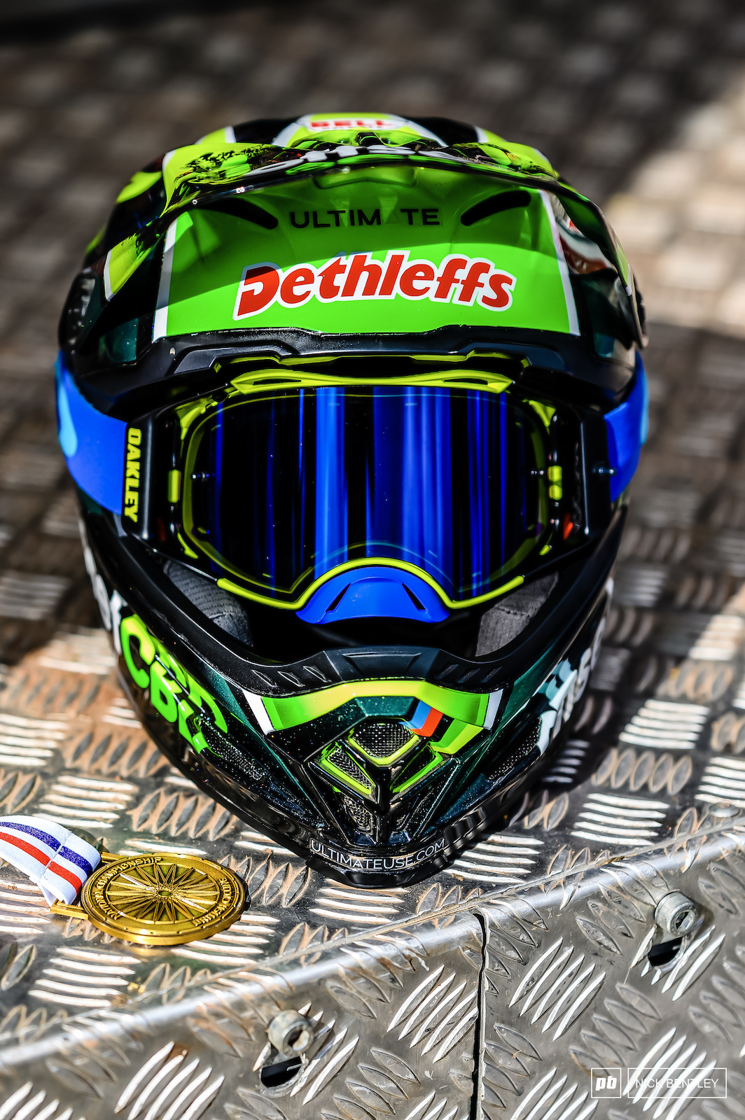 It s not everyday you see a National Championships Gold medal just chilling out on the podium with a custom painted Bell helmet. These both belonged to the Men s winner Scott Baumount.