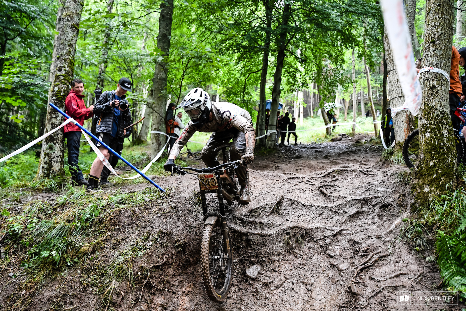 Calum Ross making his way through the mud and roots towards the last road crossing on the Innerleithen track.