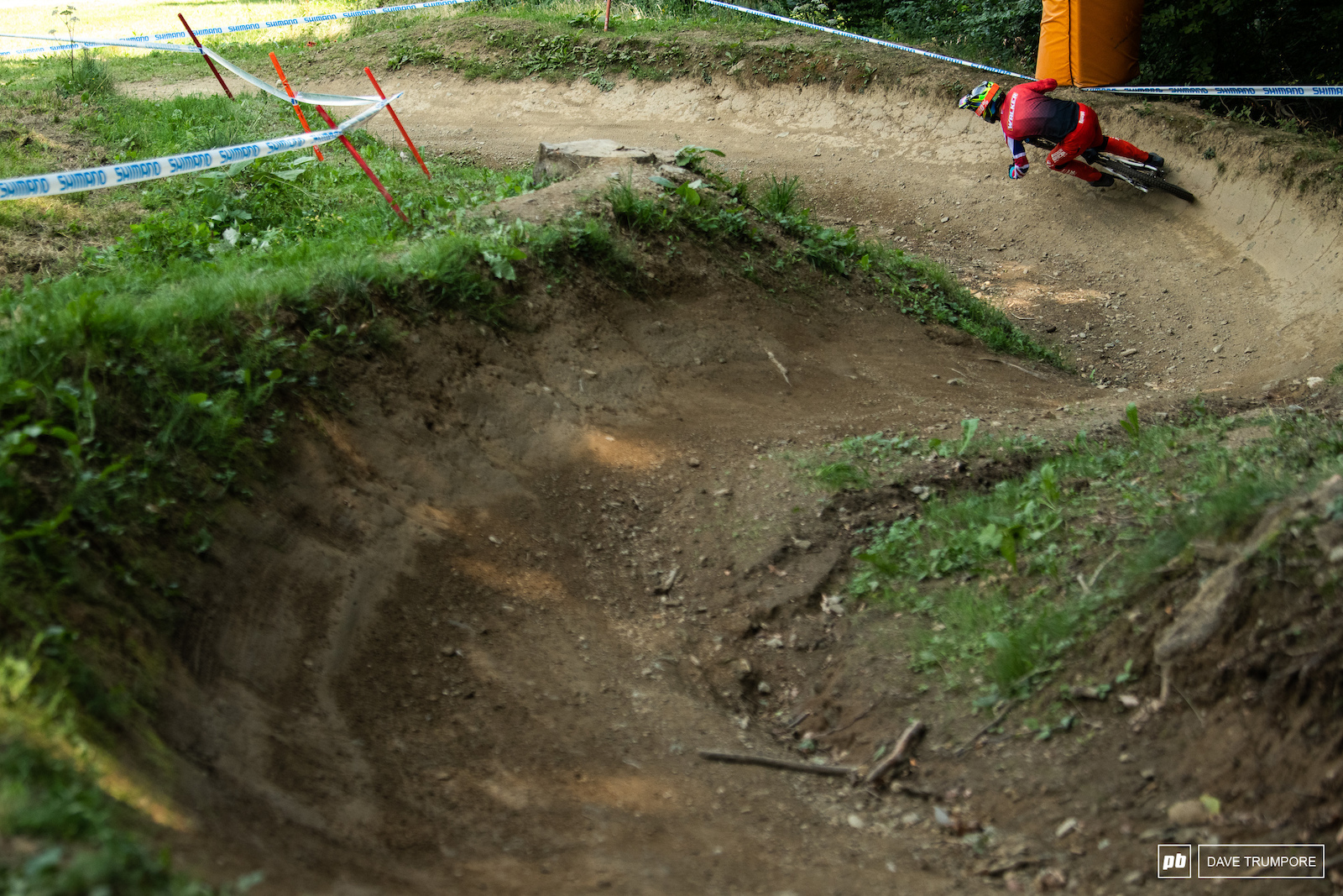 Matt Walker carving some rock hard berms near the top of the track