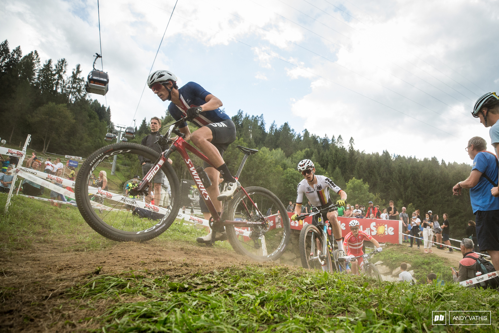 Chris Blevins making his way up the pack with Max Brandl in tow.