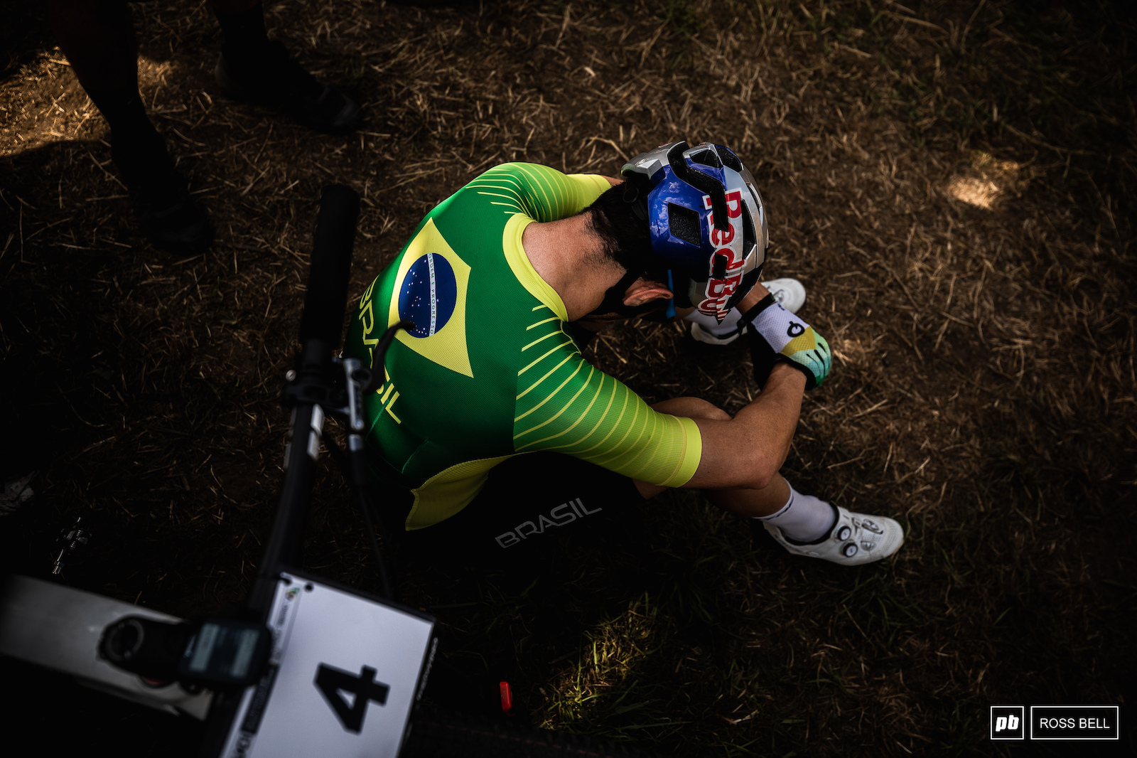 A quiet moment of contemplation for Henrique Avancini before the start of the race.