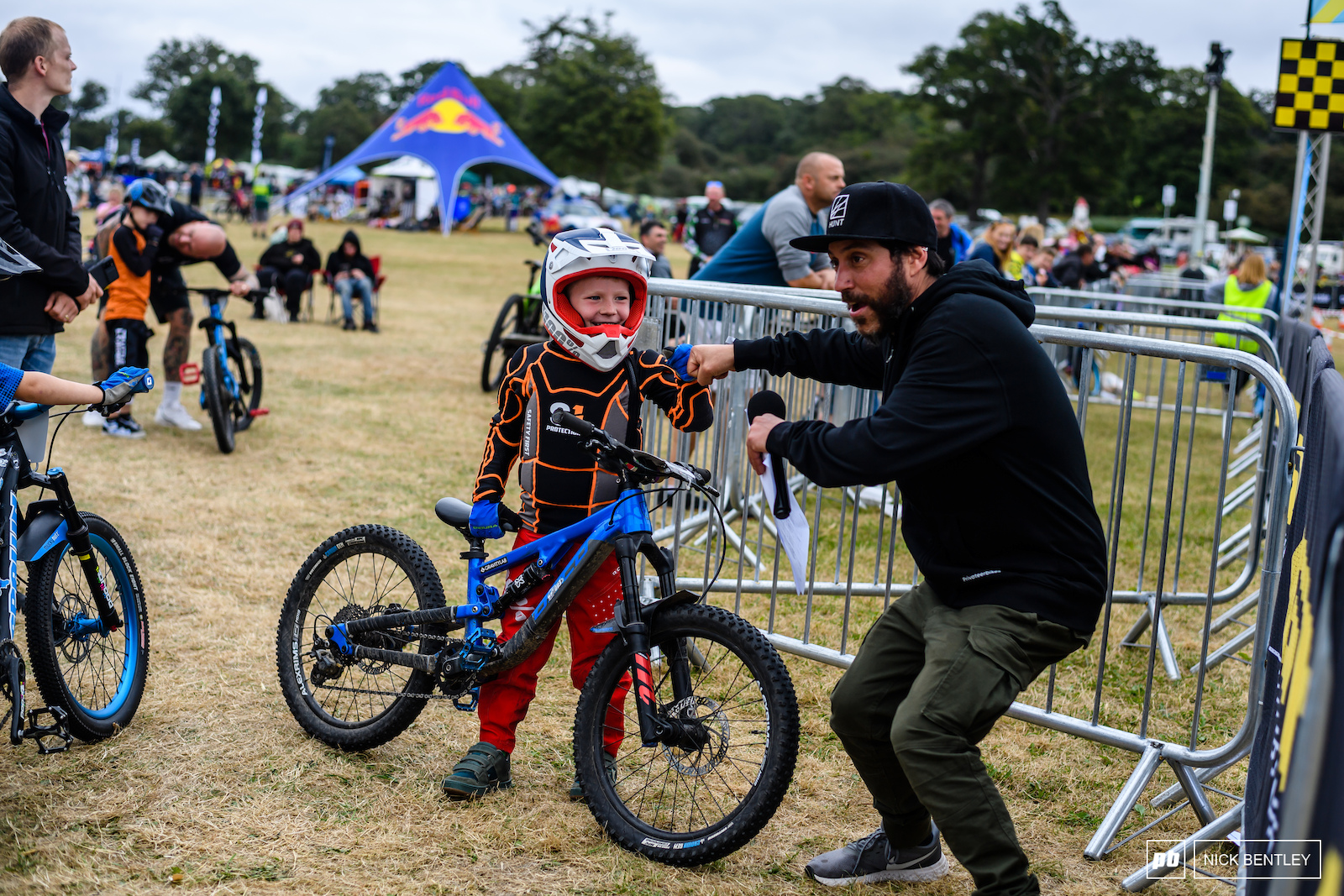 Fist bumps from Matt the Commentator for riders the atmosphere was so good for families at The Malverns Classic