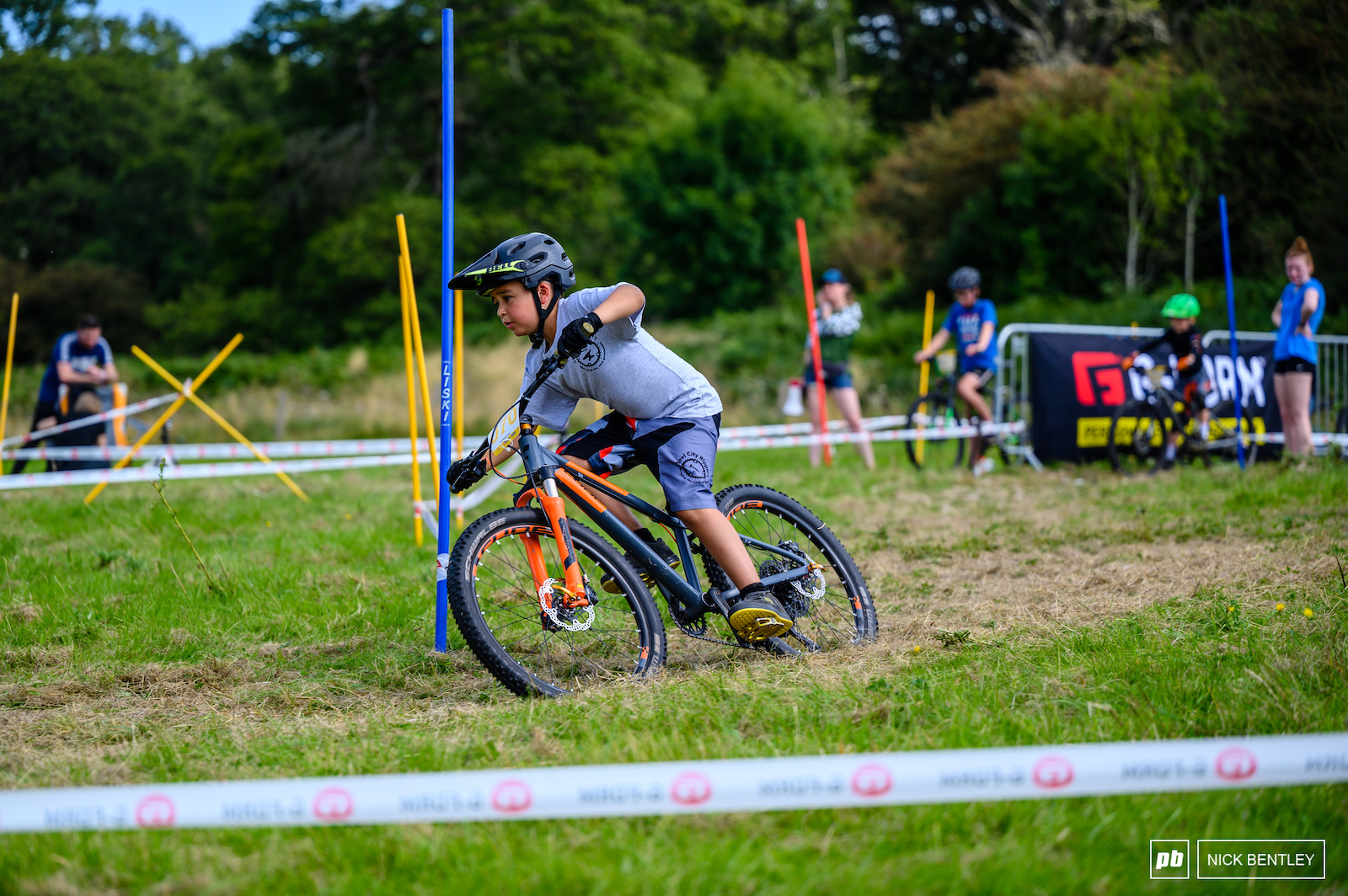 These young riders are not scared to lean in on these grass tracks