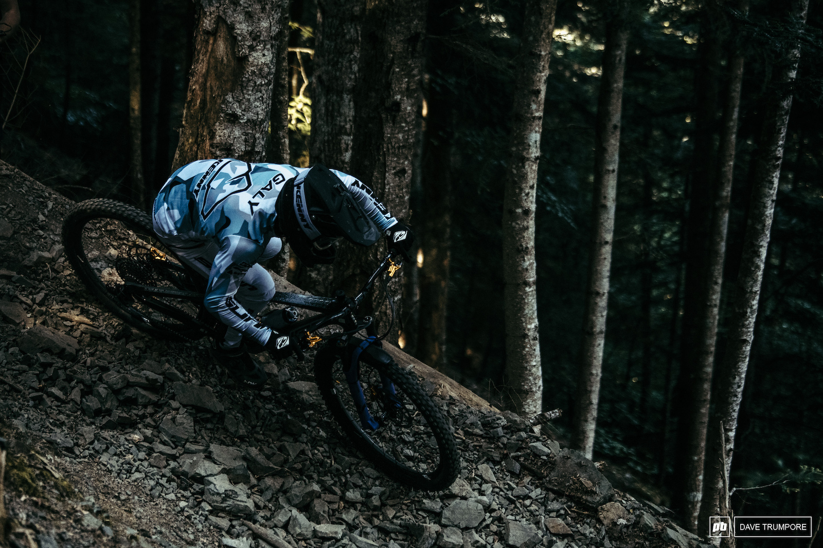 Theo Galy trying to find grip on the ever shifting rocks in the woods