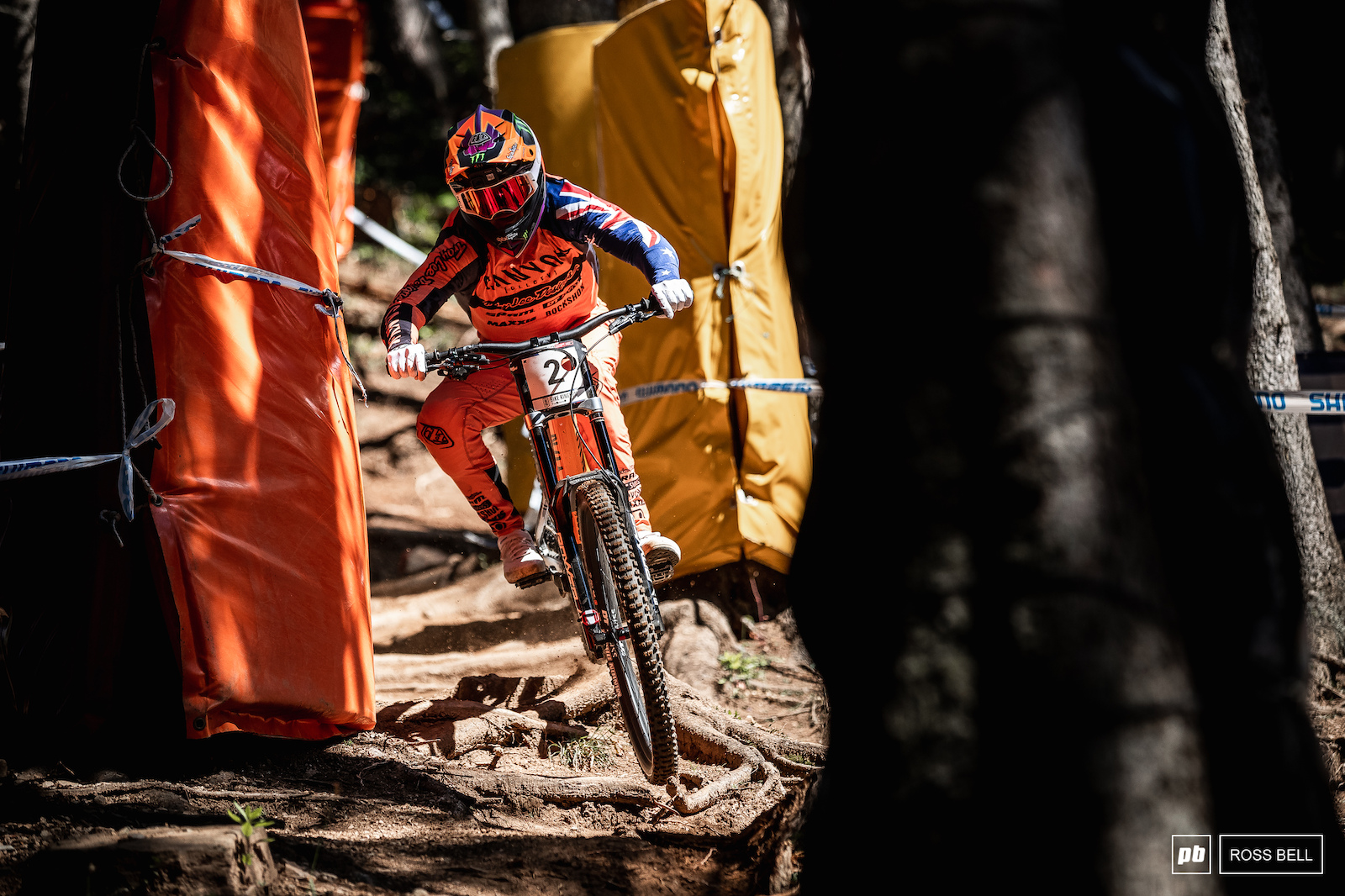 Troy Brosnan threads through the trees after the steep chute.