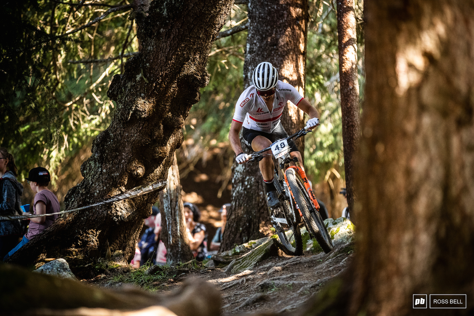 Bartlomiej Wawak cutting through the trees on the far ned of the course.