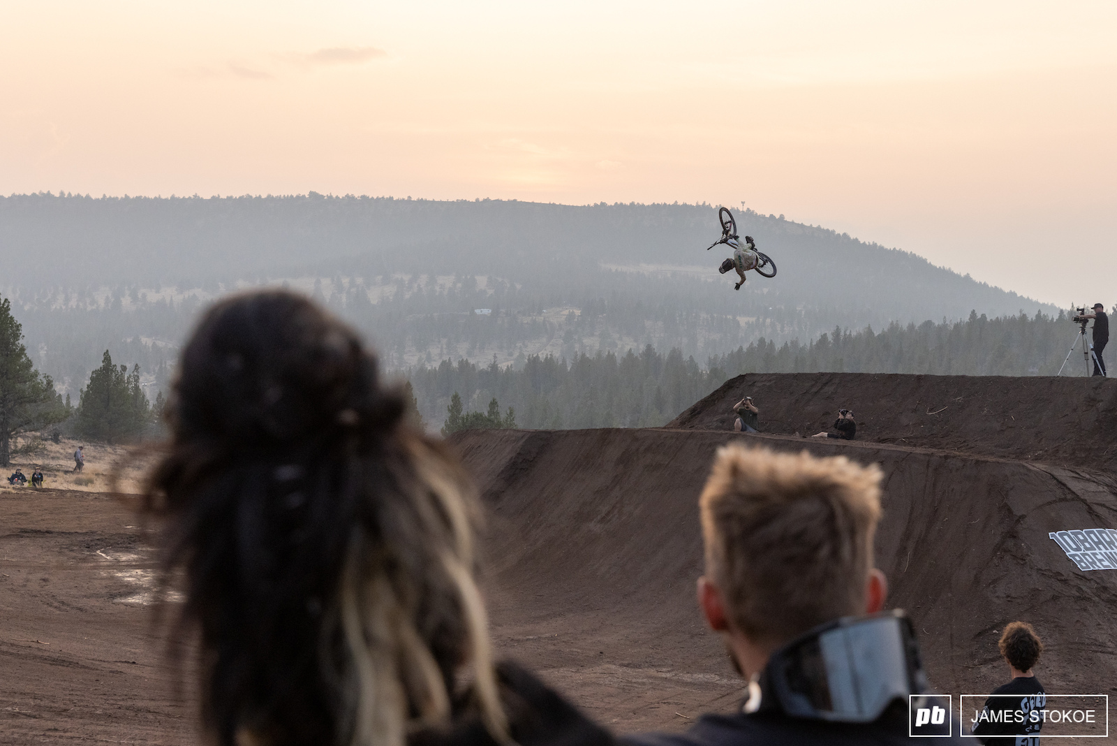 Dylan is seen here doing a backflip but instead of just backflipping on the gargantuan feature he figured dropping a hand off was a good idea. He landed this perfectly.