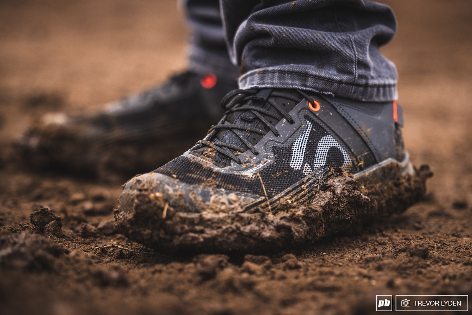 Official shoes of the event. And official mud as well.