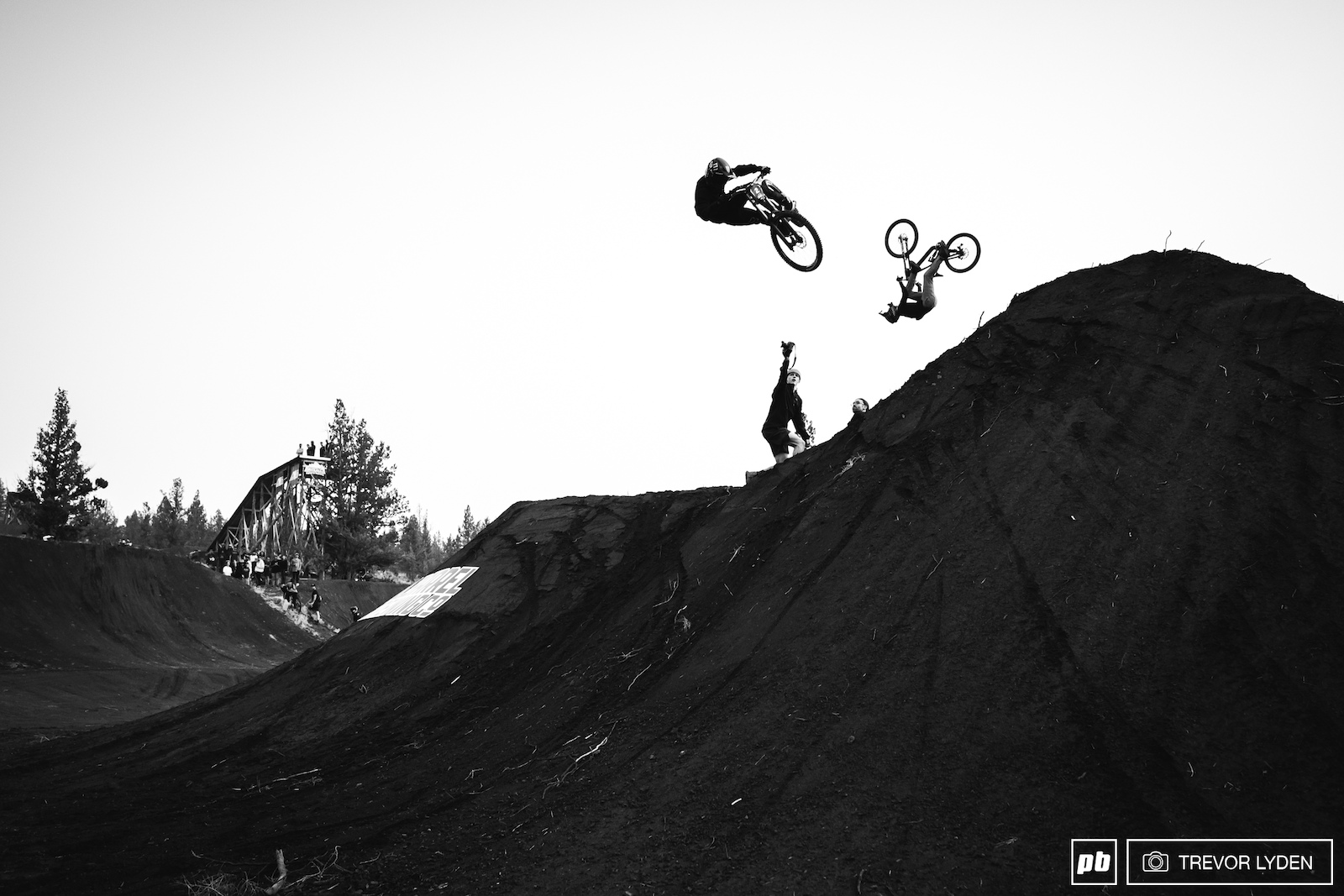Ethan and David doing synchronized offroad mountain cycling aerobatics.