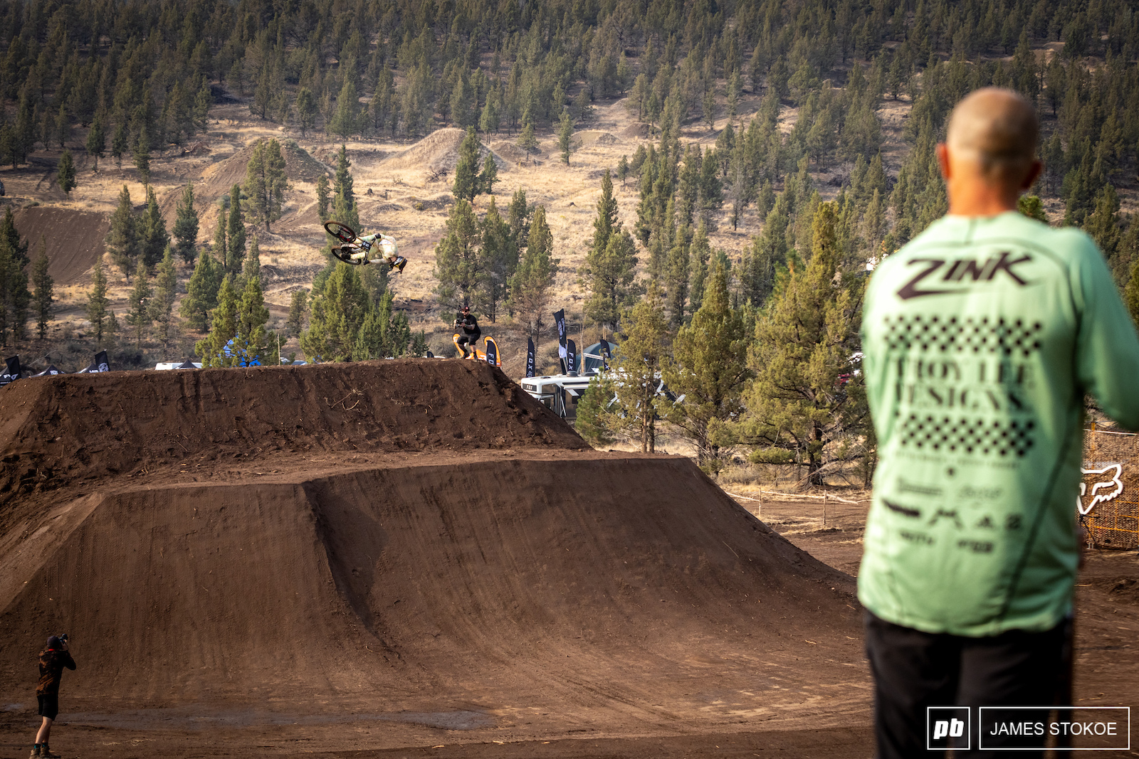 Cam Zink watching on as Dylan spins his way to a smooth landing.