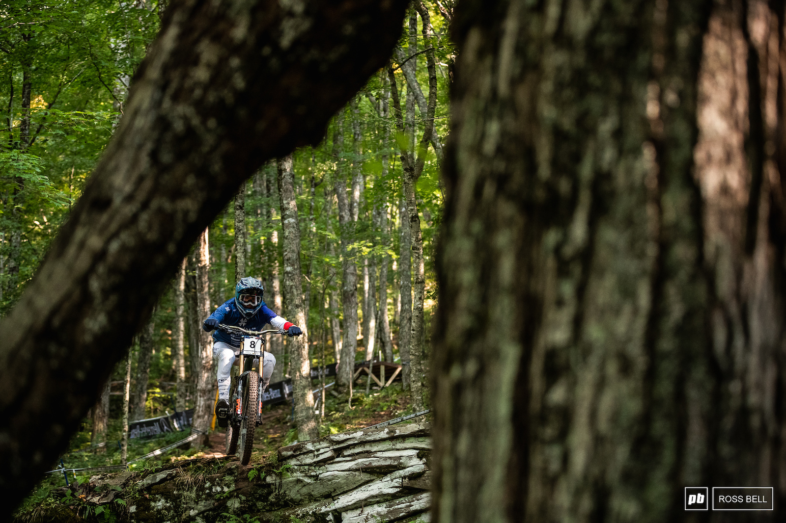 Benoit Coulanges launches off a drop in the lower woods during timed training.