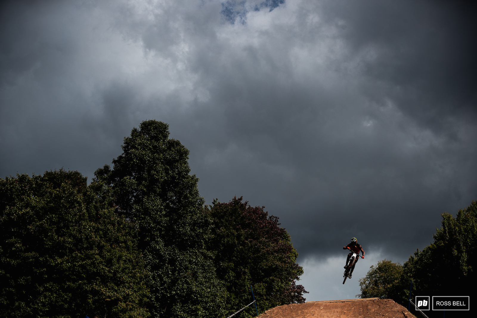 Mark Wallace launches the final jump as moody skies roll over the hills surrounding Snowshoe.
