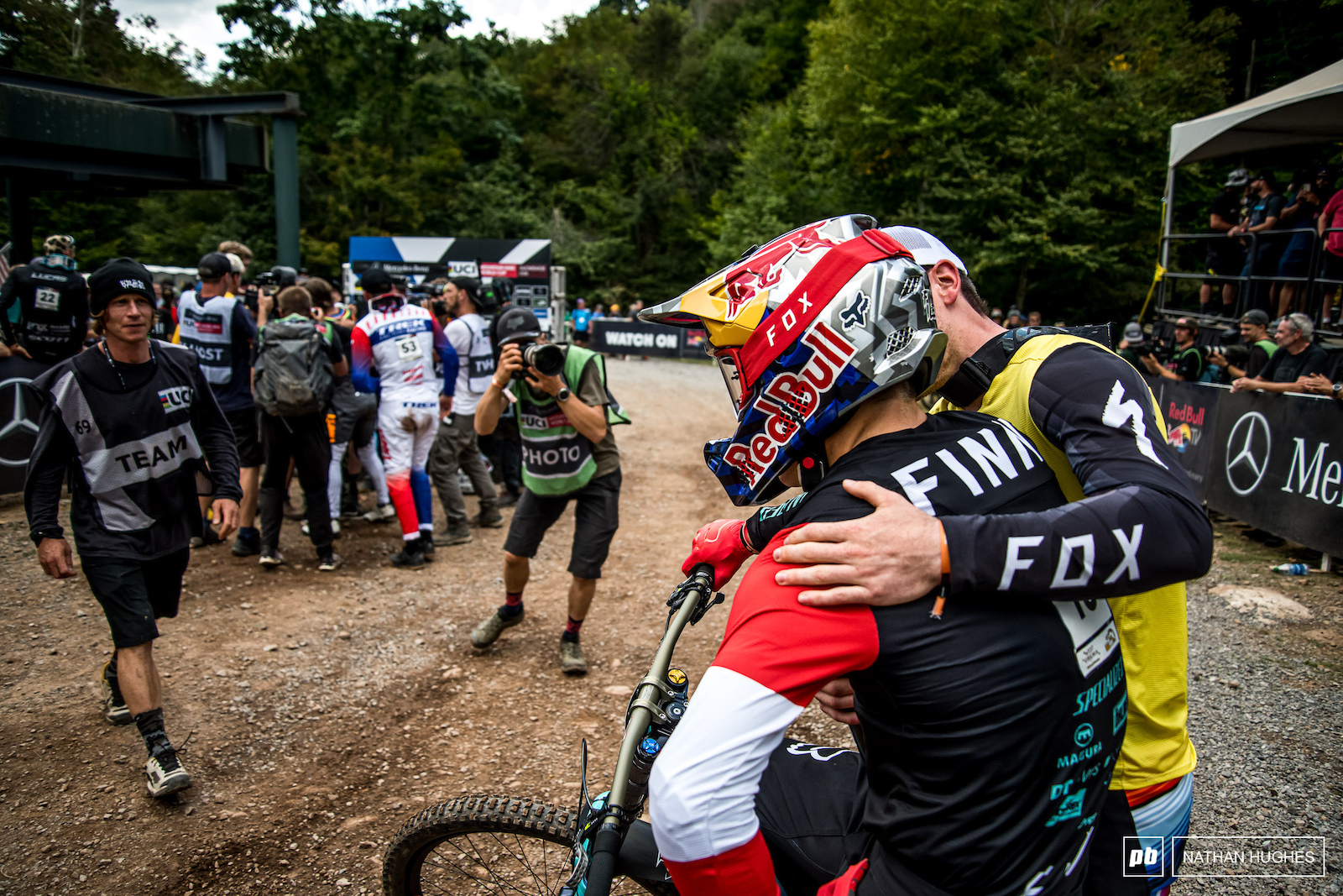 Bruni consoles and congratulates the last man down the mountain on his podium finish.