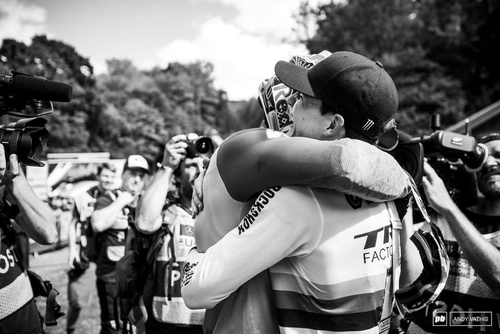 The French sure carry their heart on their sleeves. Bruni shares a moment with Loris as soon as he s lifted from the ground.