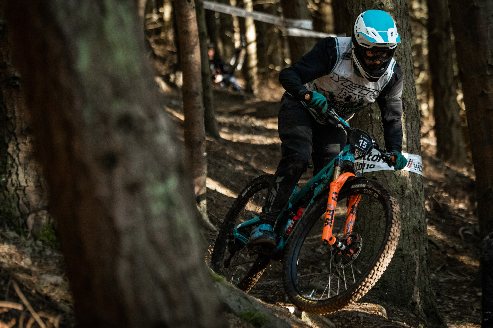 Shawn Neer through the trees on Stage 6