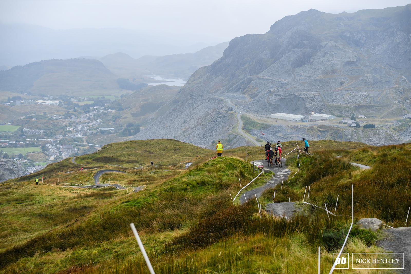 Antur Stiniog s iconic dark grey track snaking it s way down the slate strewn landscape